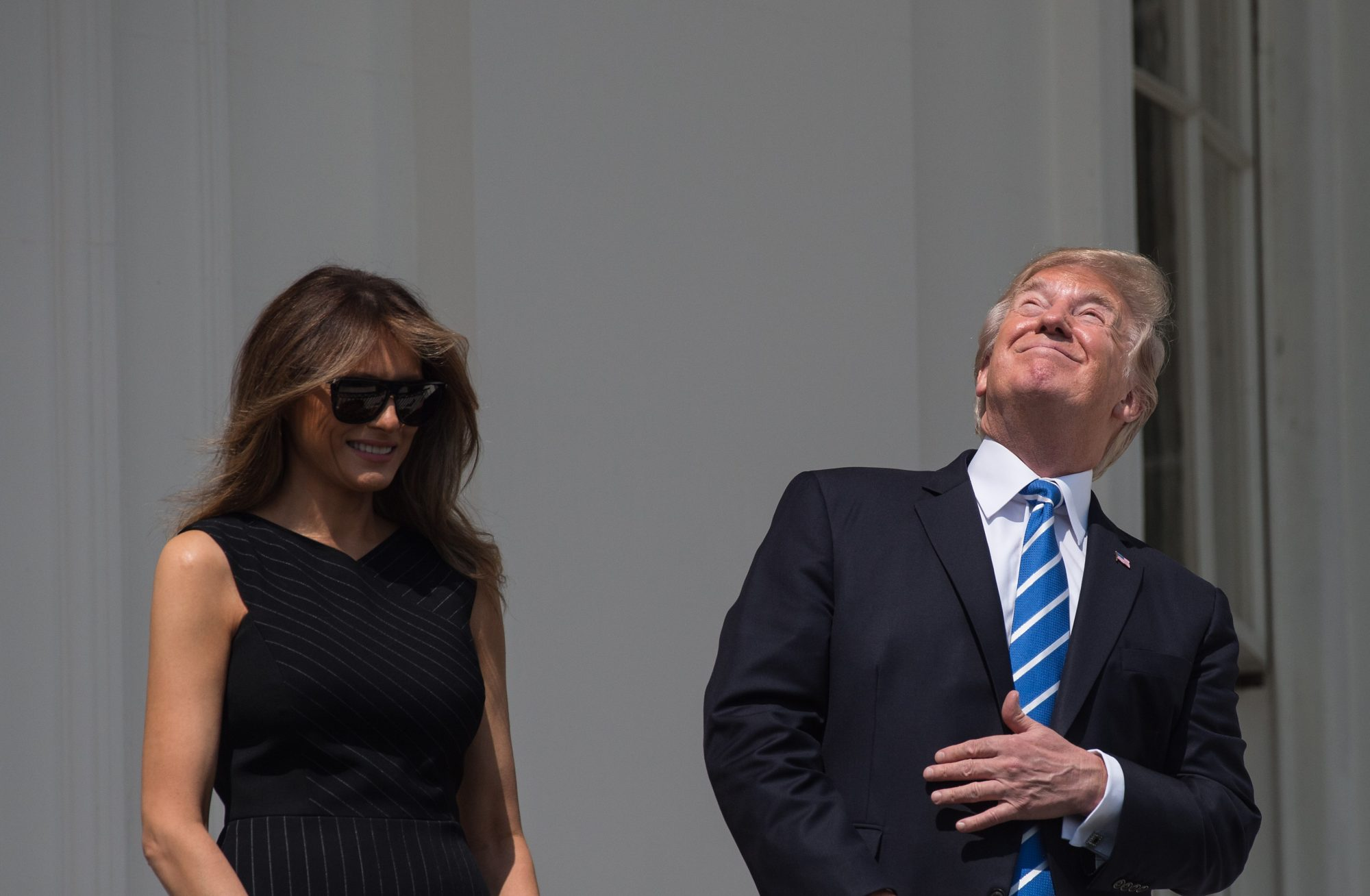 Trump Stares Directly into Sun Without Glasses as He and First Lady Melania Watch Solar Eclipse from the White House