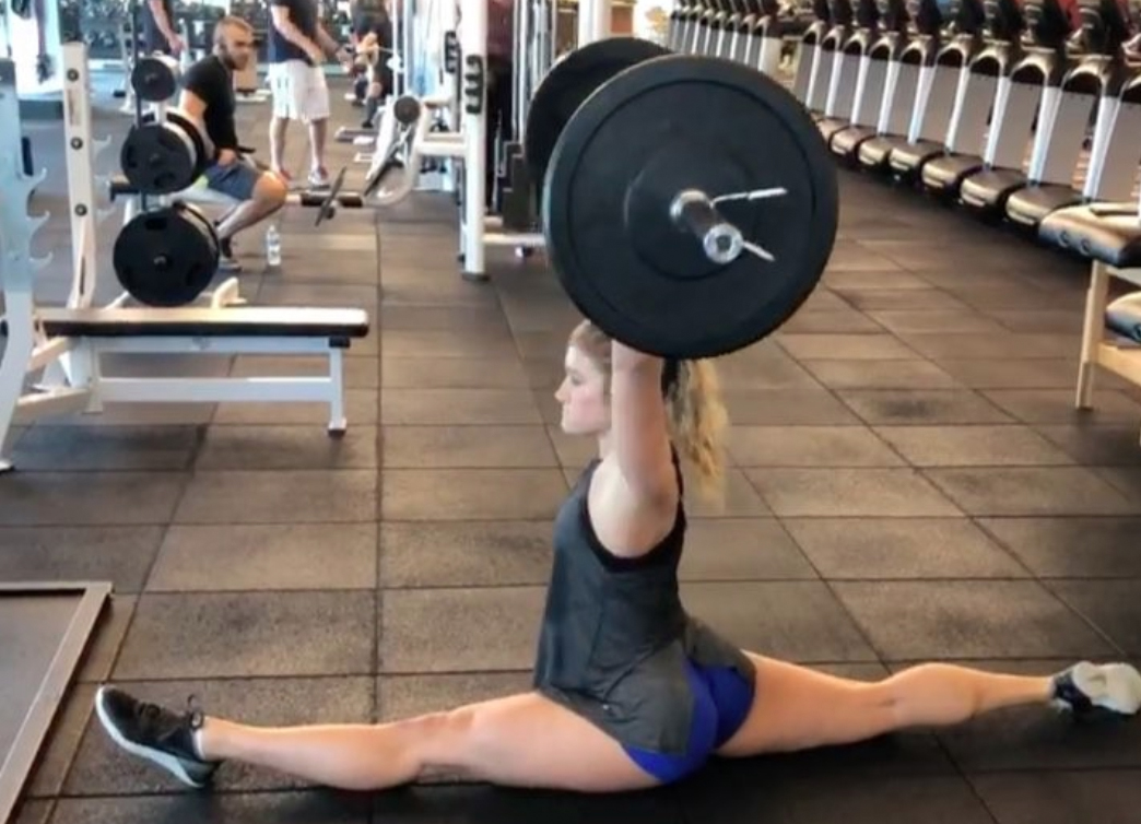 Trainer Does the Splits While Lifting 65 Lbs. Over Her Head: 'I Love Doing Silly Things with My Body!'