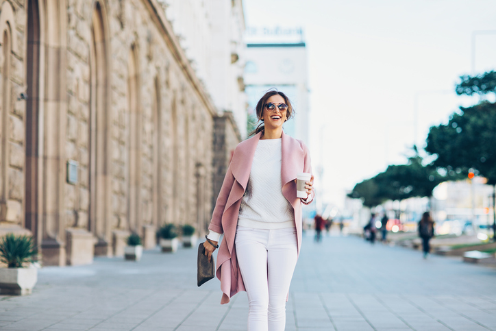 Stylish woman walking commute rush hour air pollution beauty personal care products