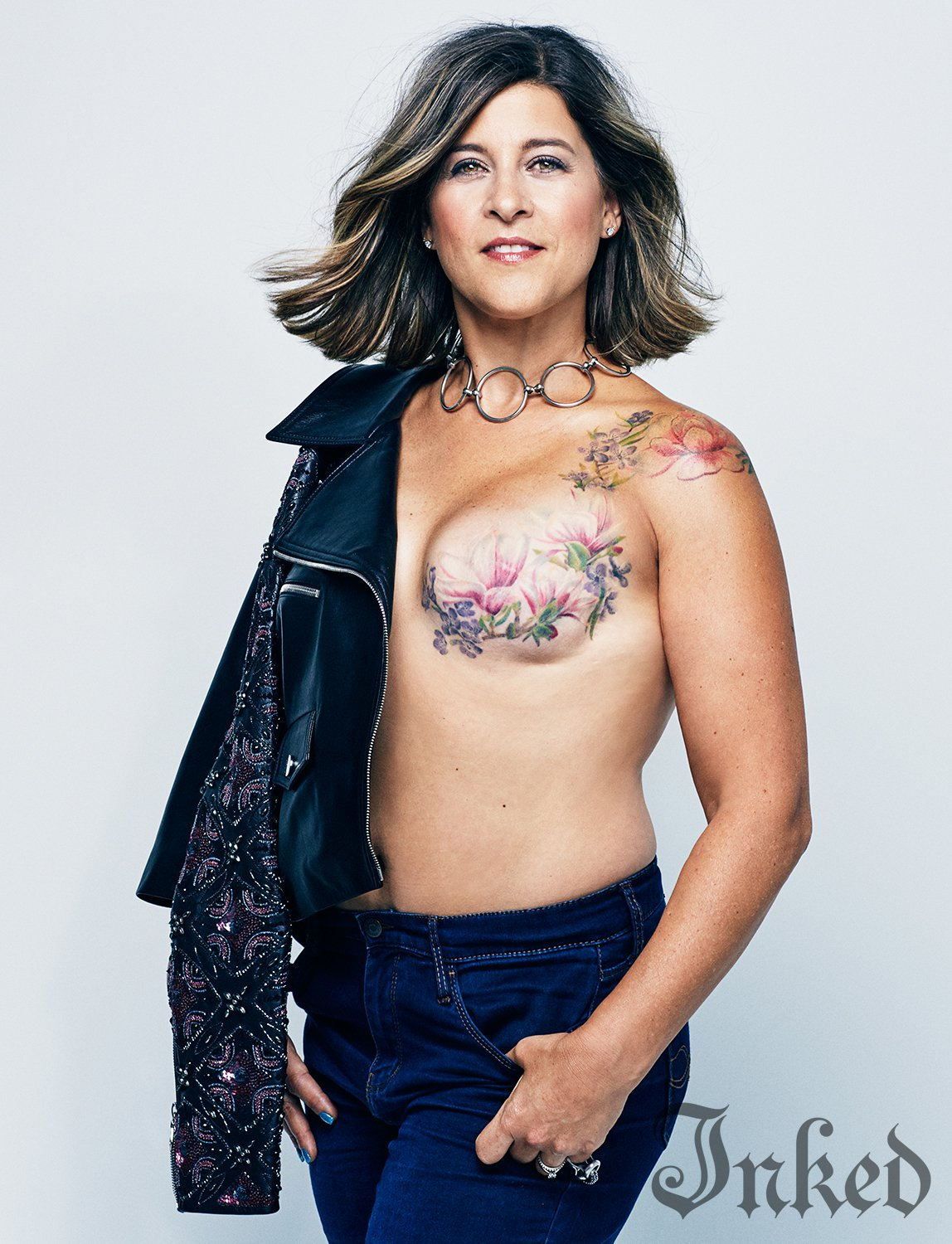 Topless women with tattoos