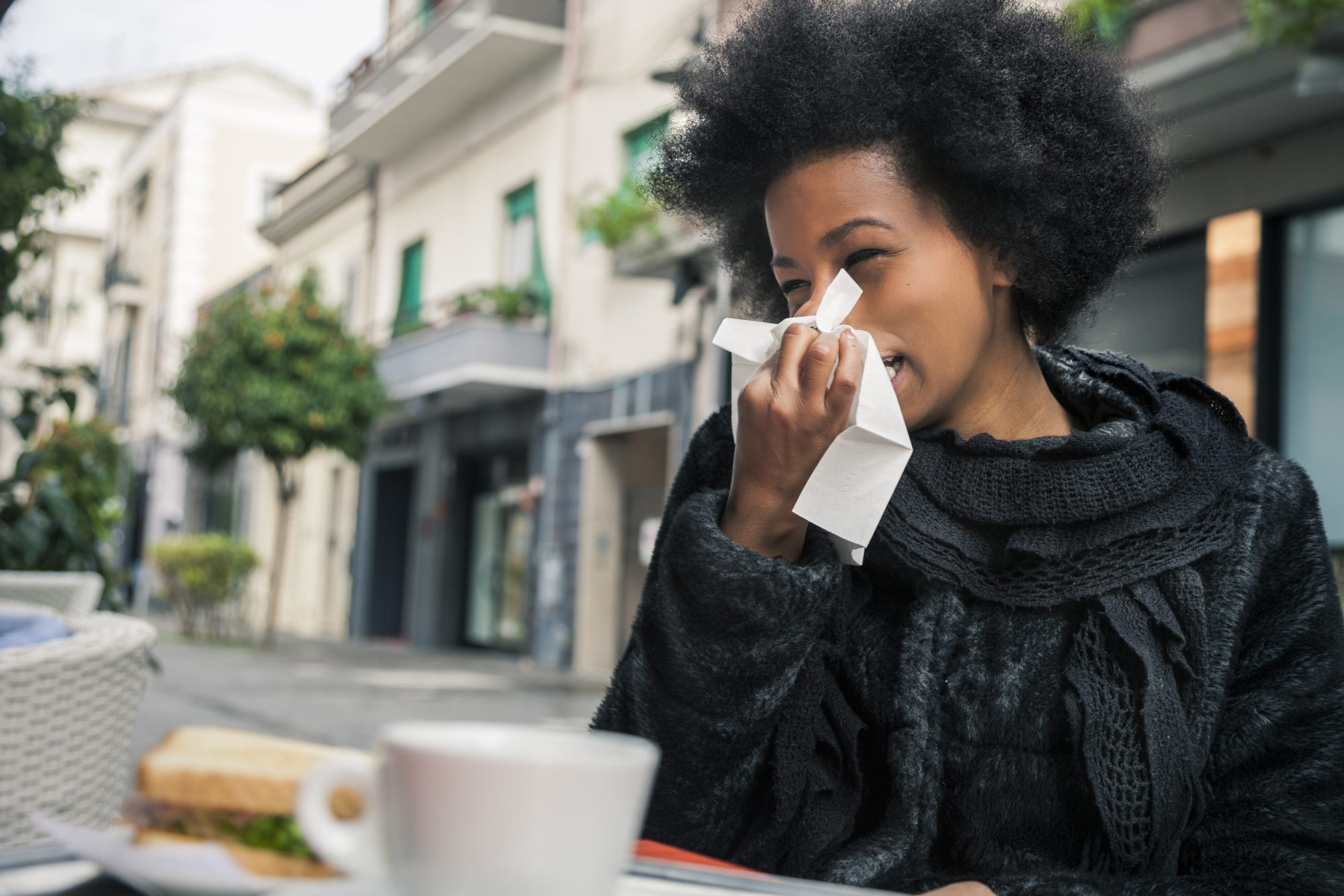 I'm coughing and sneezing.  How long is my cold or flu contagious?