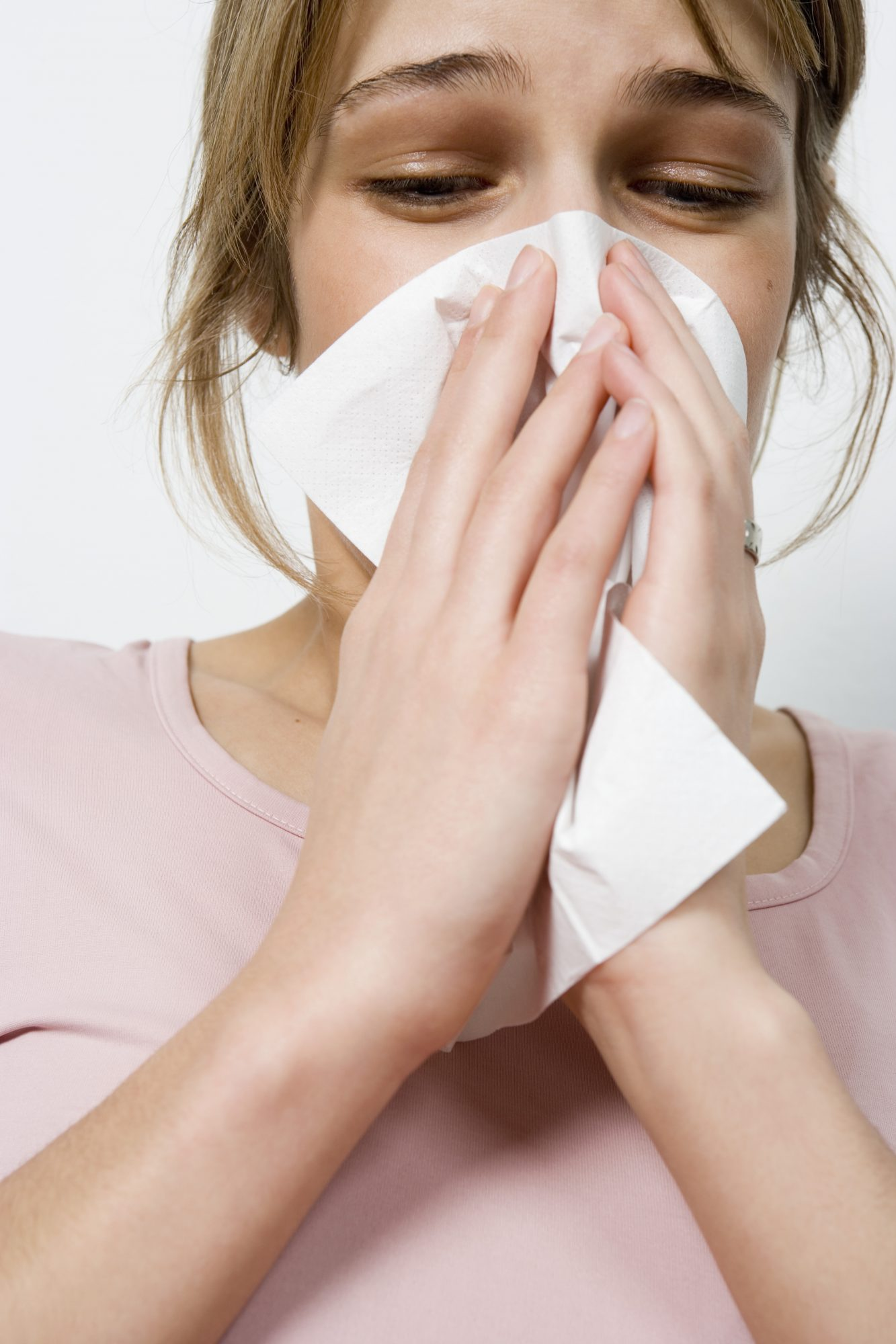 heart flu symptoms sneeze tissue booger runny nose wipe nose irritation cold virus sick woman health girl women cold season bacteria