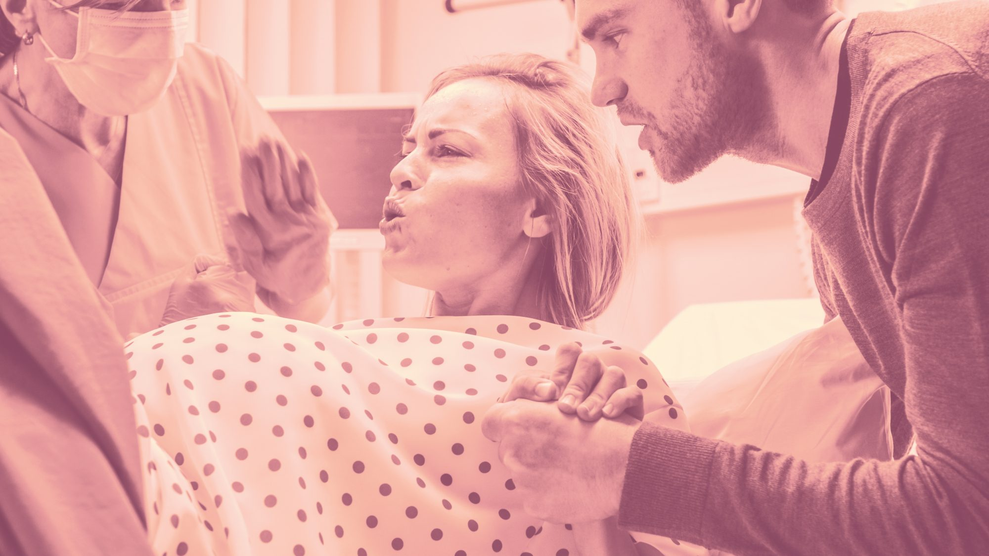 This Emotional Photo Shows a Mom Touching Her Baby's Head While Giving Birth