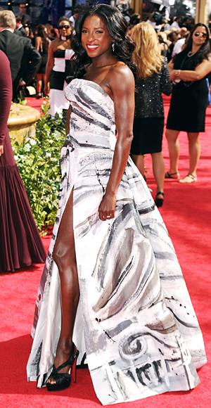 Rutina Wesley wearing white gown curls and red lips at the 62nd Emmy Awards in Hollywood, CA