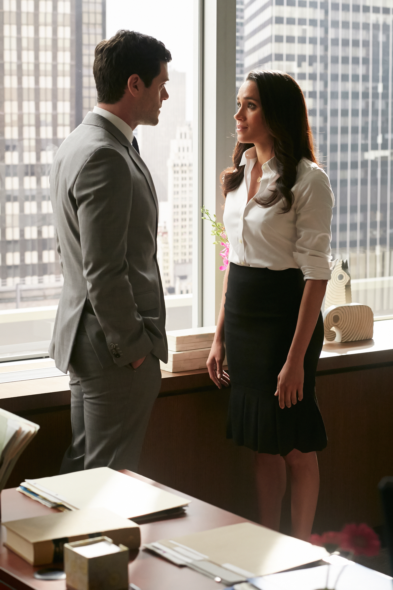 "SUITS -- ""We're Done"" Episode 407 -- Pictured: (l-r) Brendan Hines as Logan Sanders, Meghan Markle as Rachel Zane"