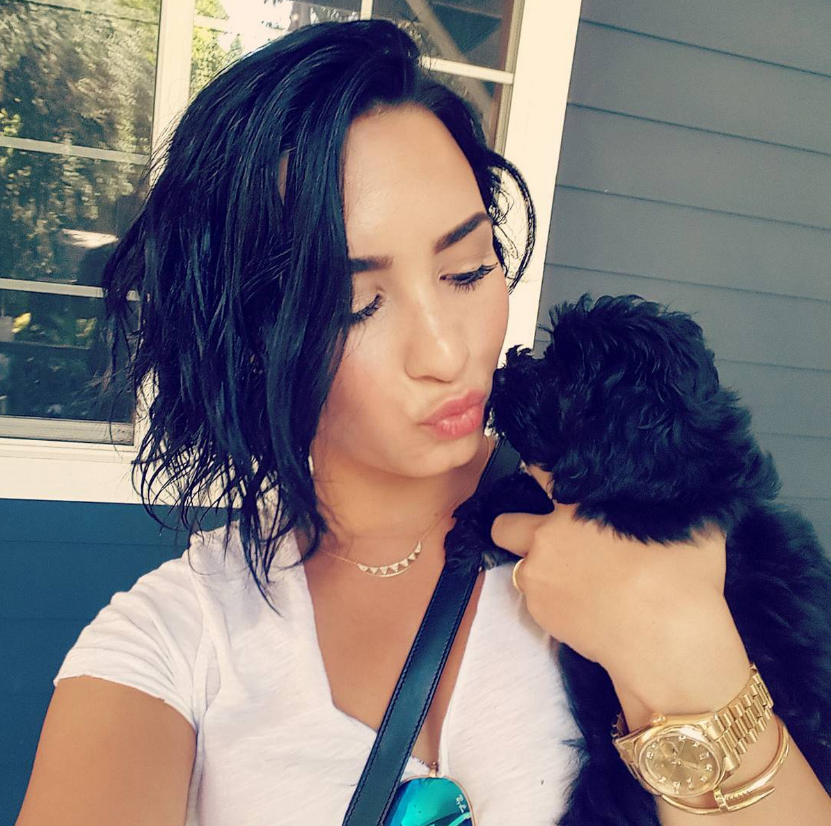 Demi Lovato posts a picture to Instagram of her and a puppy