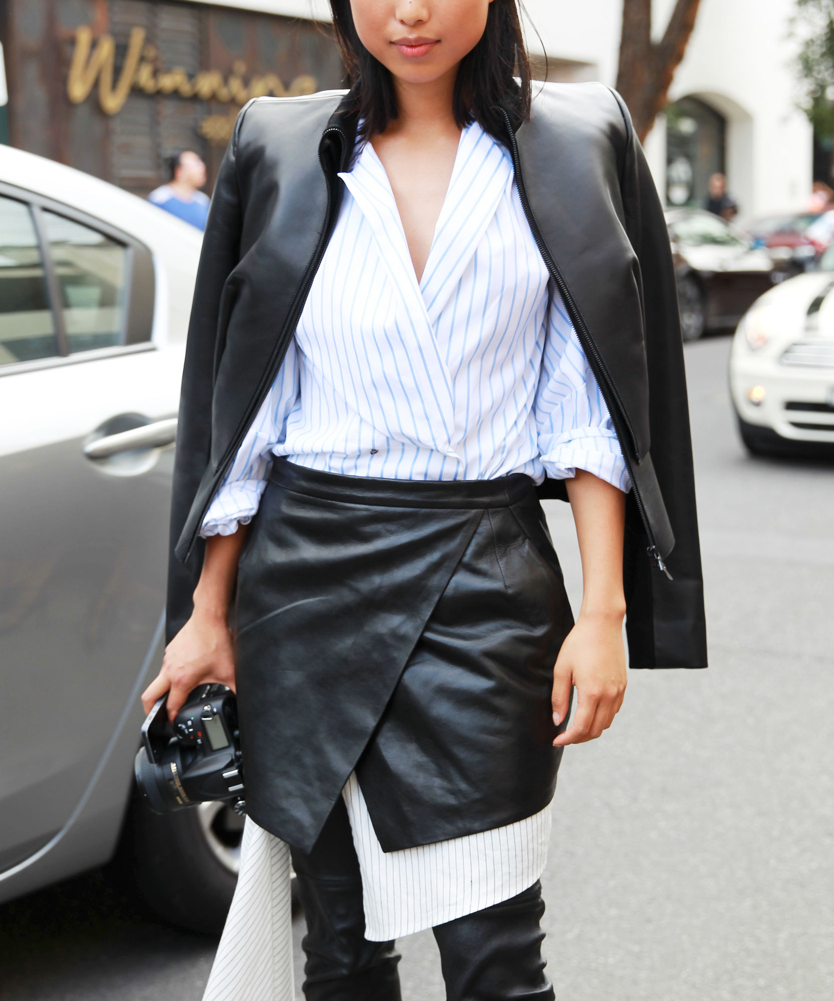 Margaret Zhang wearing Dion Lee jacket and skirt, Michael Lo Sordo shirt and Givenchy boots attends the Dion Lee show during Mercedes-Benz Fashion Week Australia 2014 at 7 Danks Street, Waterloo on April 9, 2014 in Sydney, Australia.