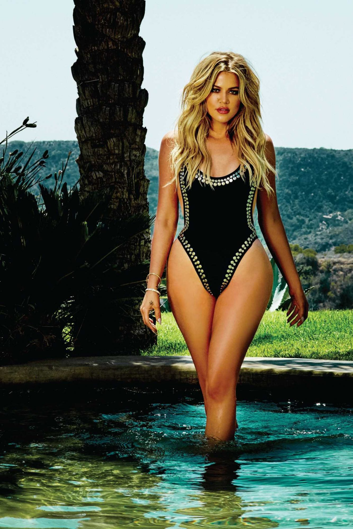 Khloe Kardashian Wears Bathing Suit Inside Book Strong