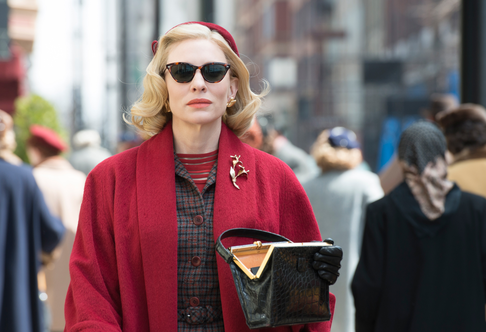 While Carol wears cat-eye sunglasses, they aren't your modern day specs.