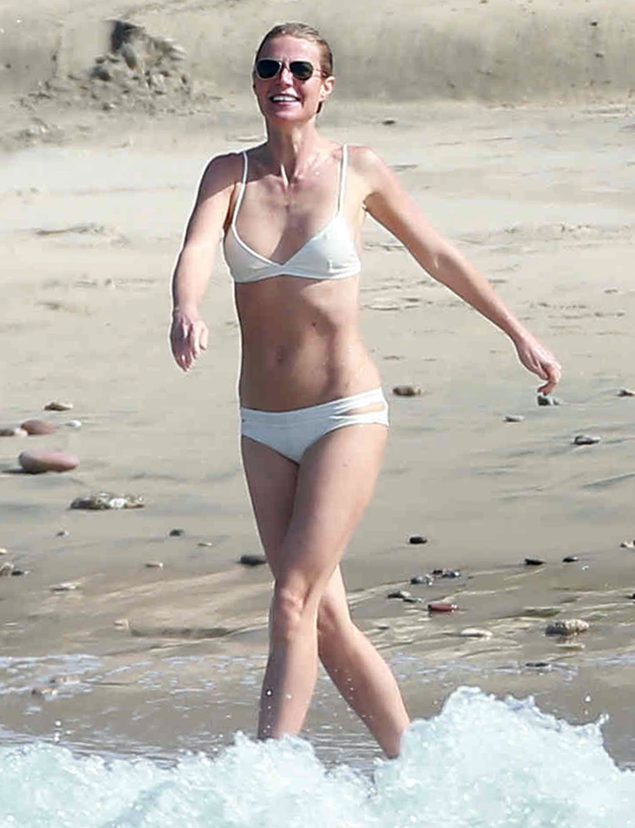 Gwyneth Paltrow Shows Off Her Toned Figure in a White Hot Bikini in Mexico