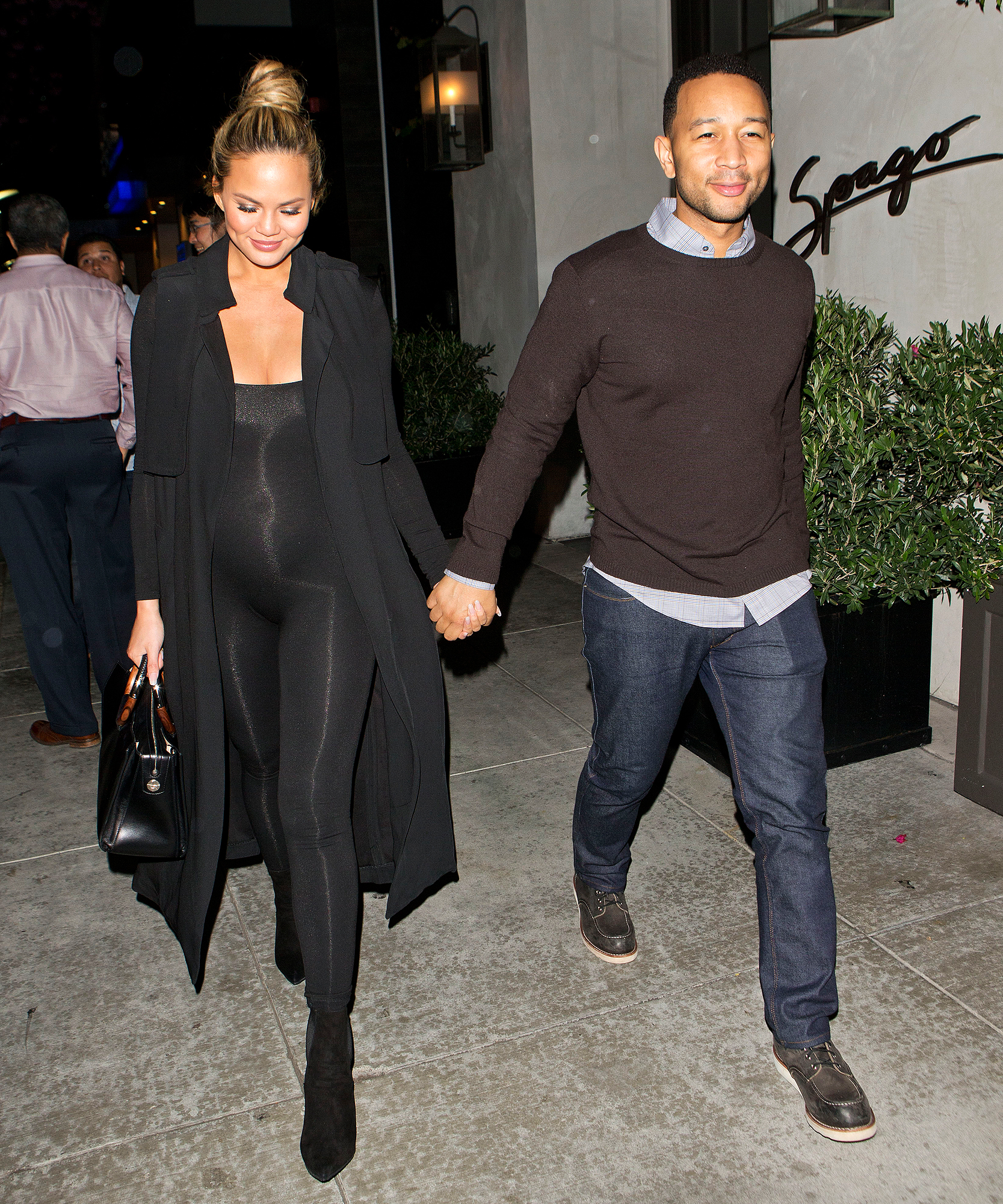 Chrissy Teigen Shows Off Her Baby Bump in Skin-Tight Bodysuit