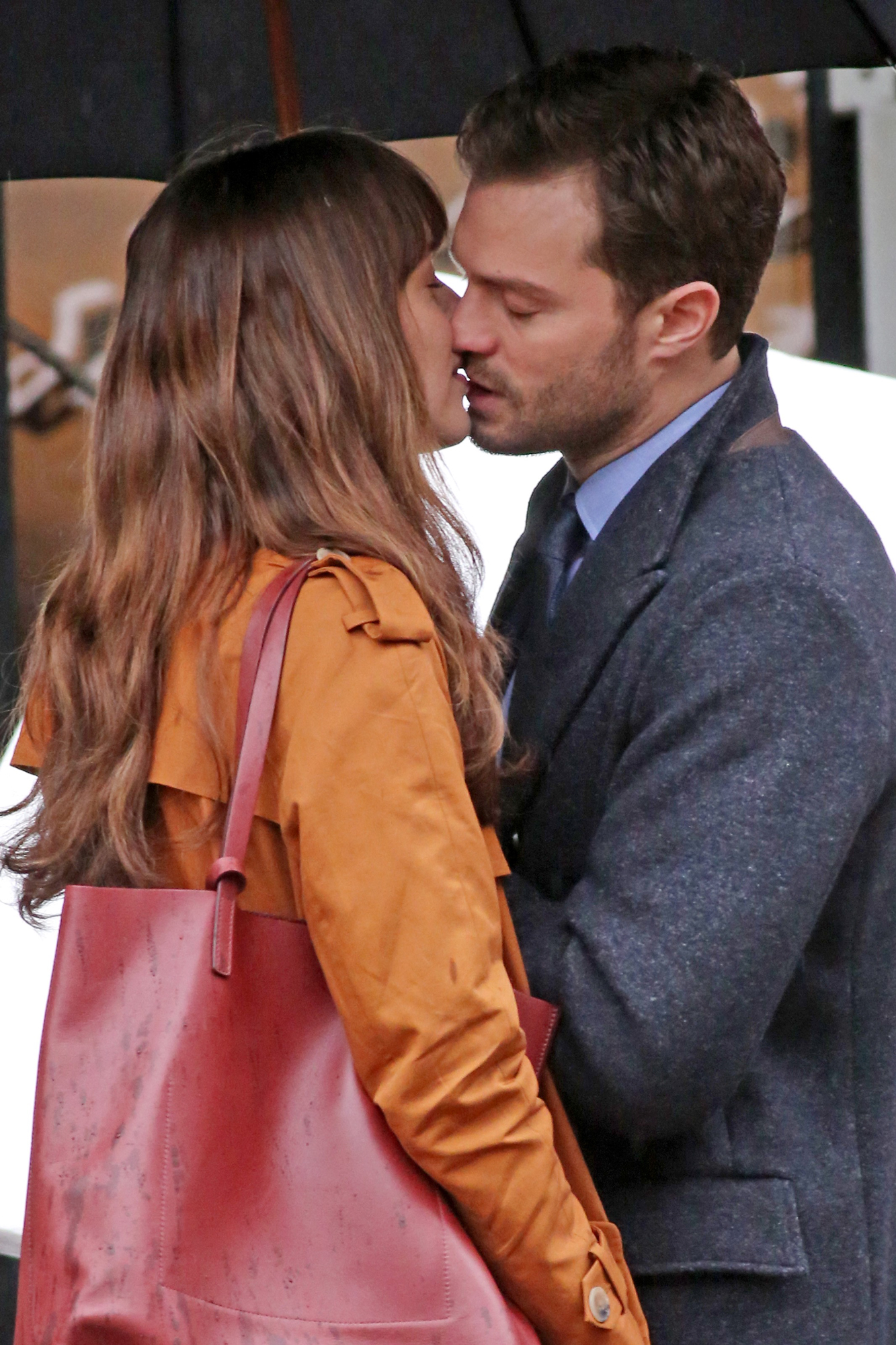 "Dakota Johnson and Jamie Dornan share an intimate moment on the set of the erotic movie ""50 Shades Darker""."