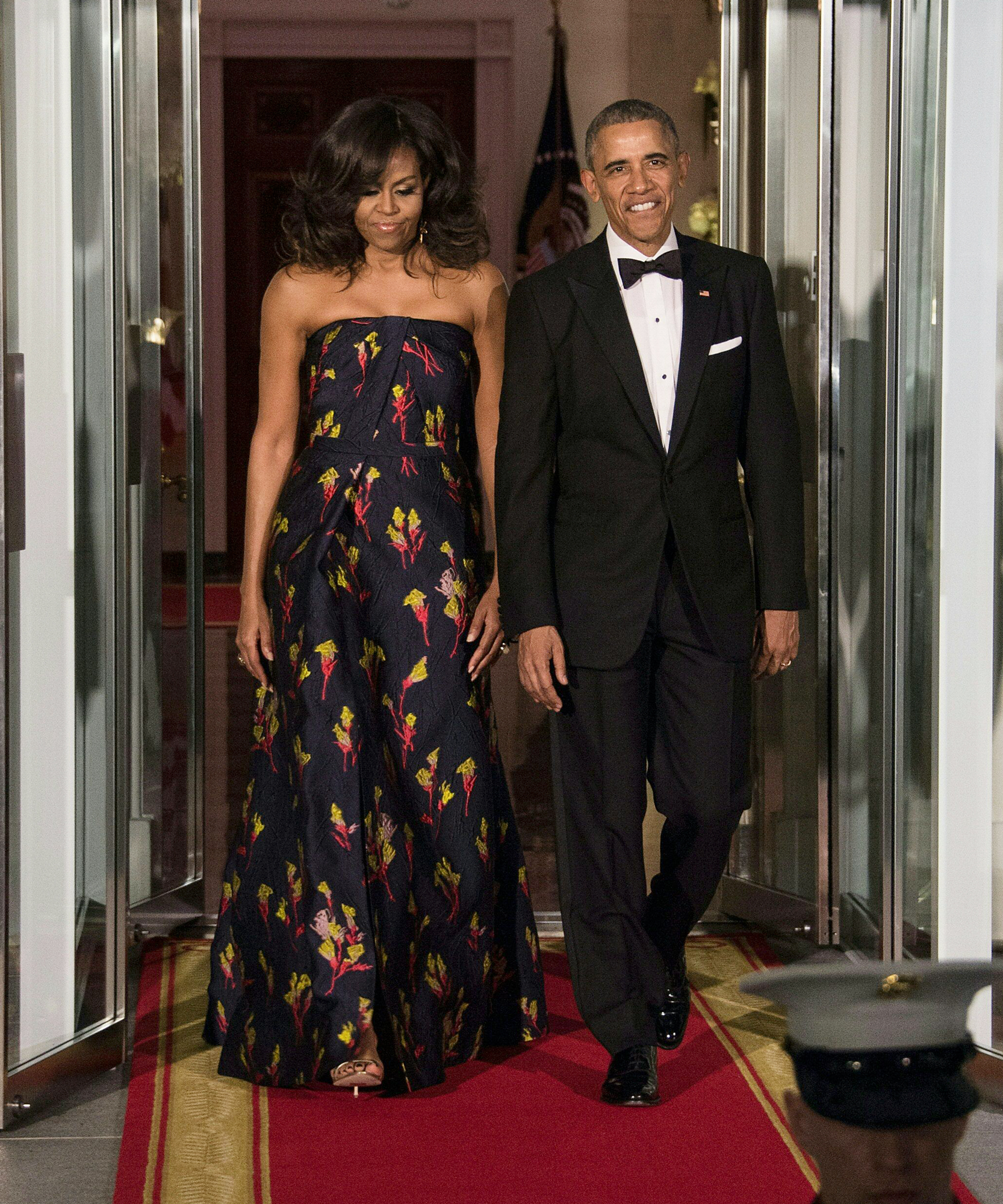US President Barack Obama and First Lady Michelle Obama walk out to greet Canadian Prime Minister Justin Trudeau and his wife Sophie Gregoire Trudeau for a State Dinner in their honor at the White House in Washington, DC, on March 10, 2016.
