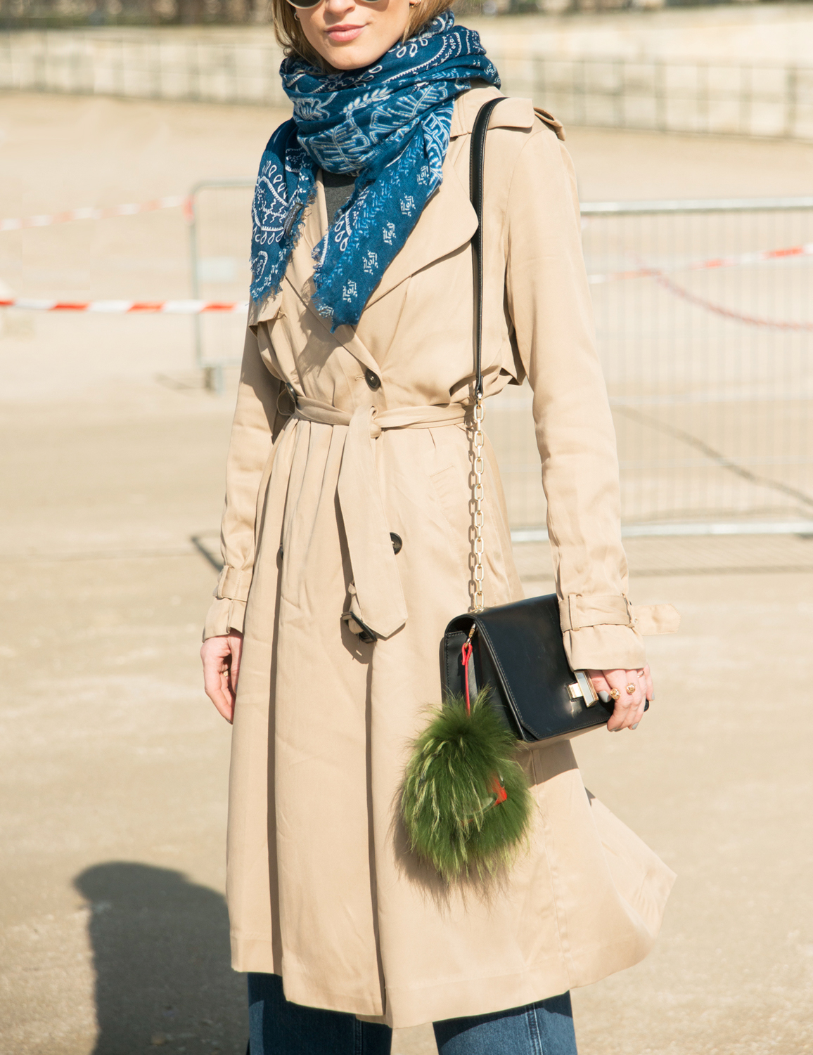 PARIS, FRANCE - MARCH 05: Fashion blogger Noor De Grout wears Ray Ban sunglasses, Justice trench coat, H&M trousers, & Other stories bag on day 3 of Paris Collections: Women on March 05, 2015 in Paris, France.  (Photo by Kirstin Sinclair/Getty Images)***