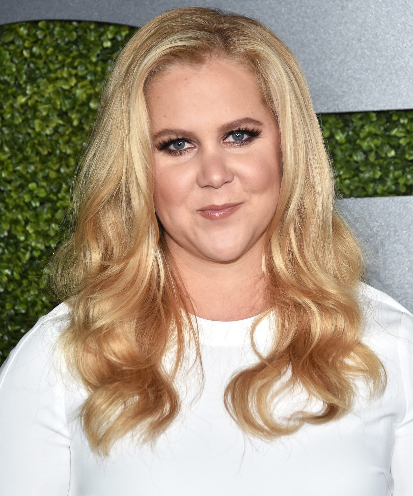 Amy Schumer's Tropical Vacay Consists of Two Things: Flawless Bikinis and an Adoring Beau