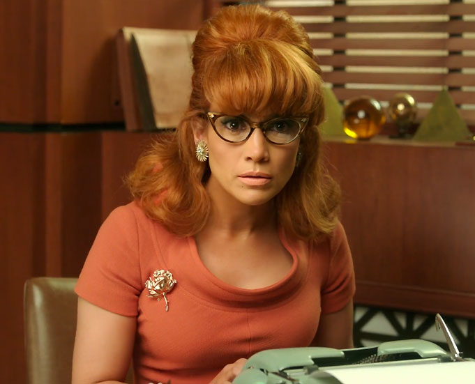 <p>In an orange shift dress and wig.</p>