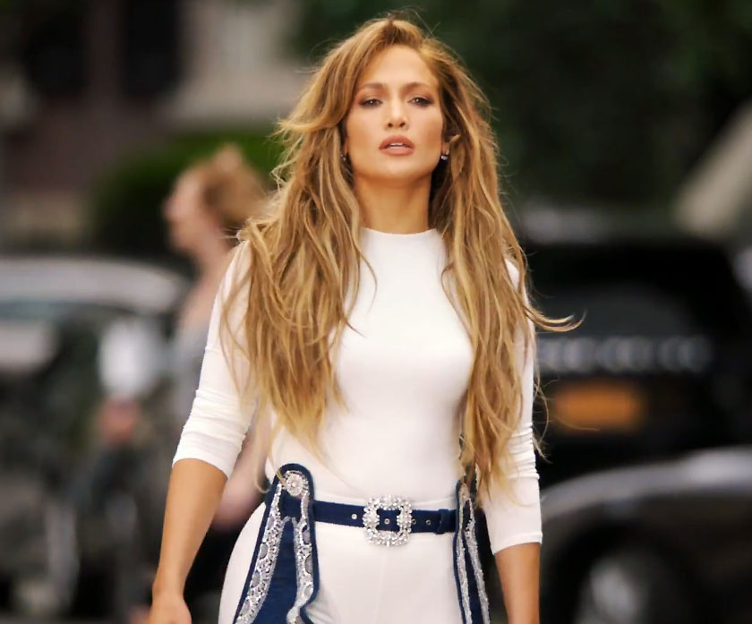 <p>In a white bodysuit and Manolo Blahnik boots.</p>