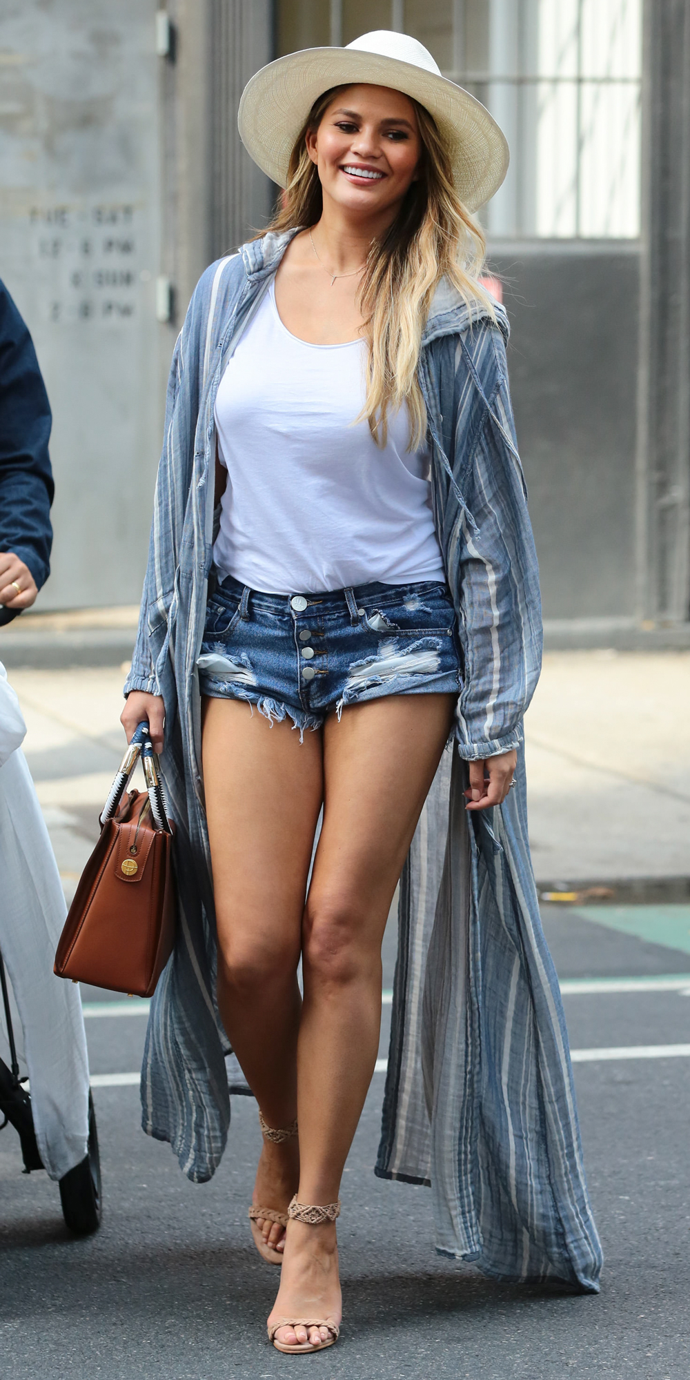 Chrissy Teigen Shows Off Her Mile-Long Legs, Hits N.Y.C. Streets in Short Shorts