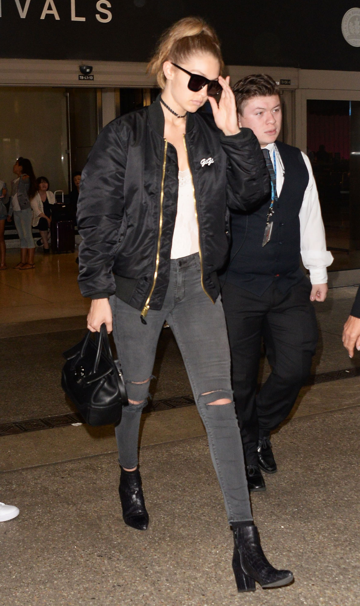 Gigi Hadid Wears a Bomber Jacket with Boyfriend Zayn Malik's Name Written on It