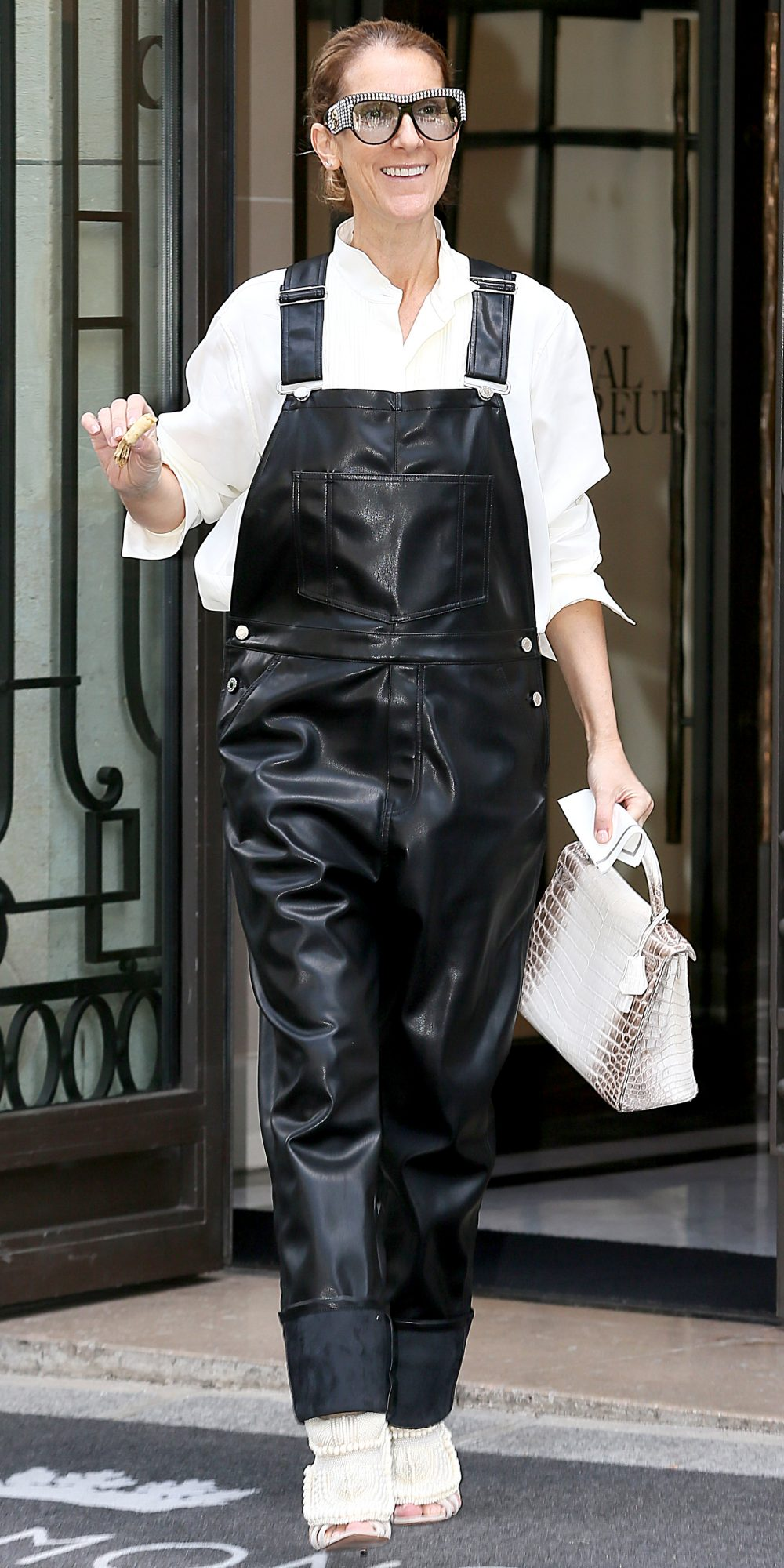 <p>IN BLACK LEATHER OVERALLS</p>