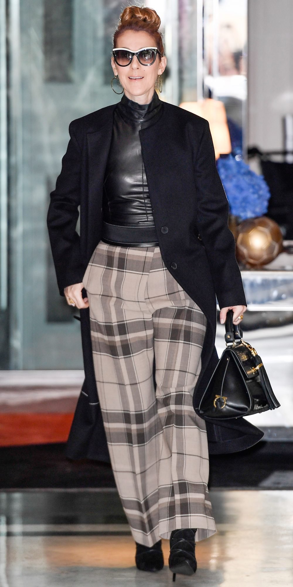 <p>IN TAUPE-TONED PLAID</p>