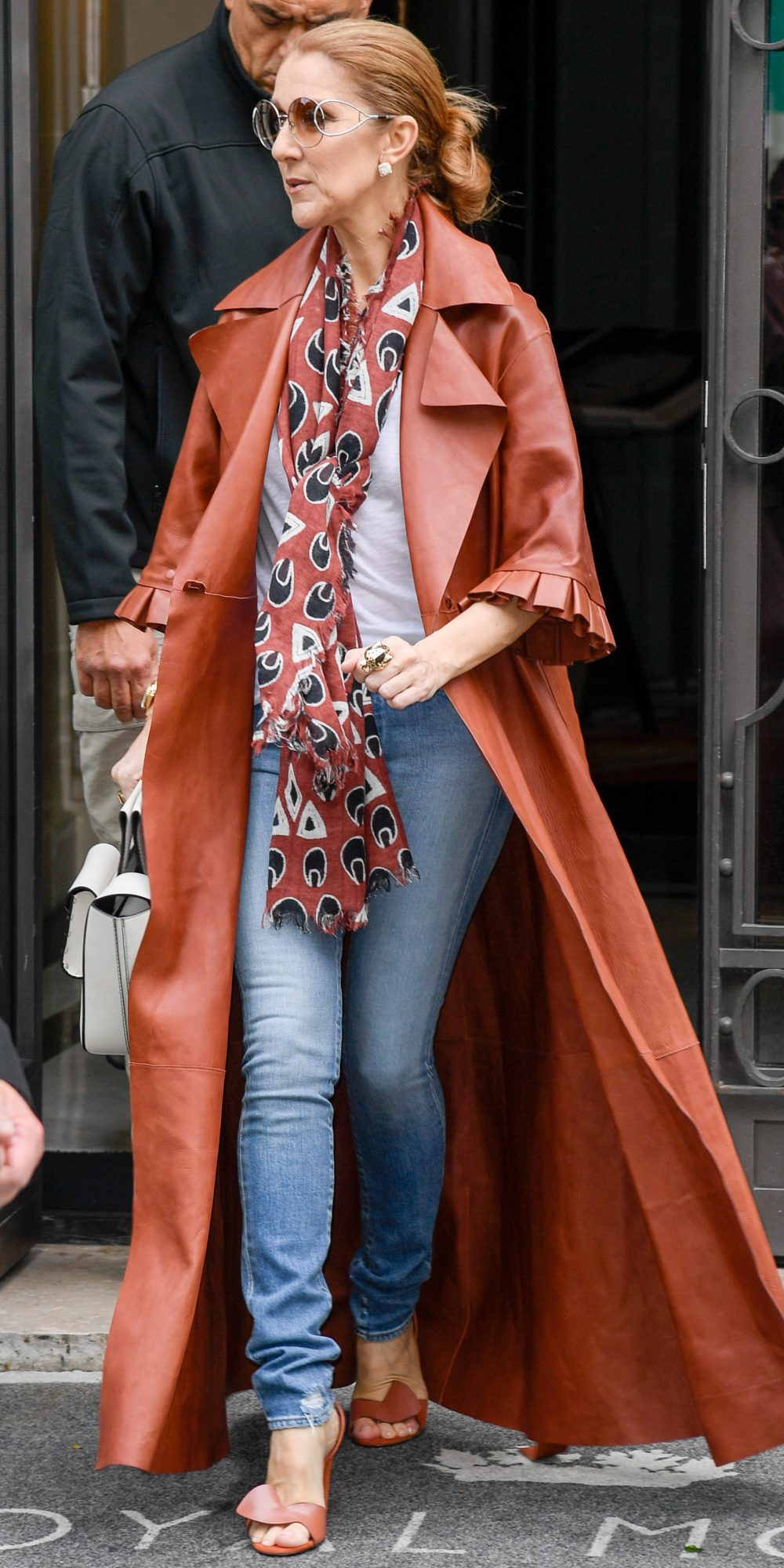 IN A BRICK RED LEATHER COAT