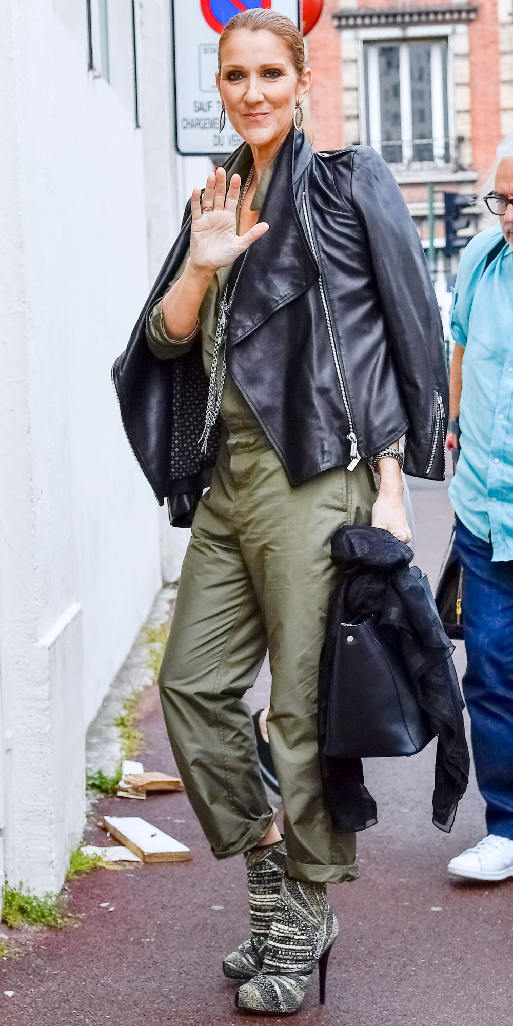 IN A MILITARY GREEN JUMPSUIT AND SPORTY LEATHER