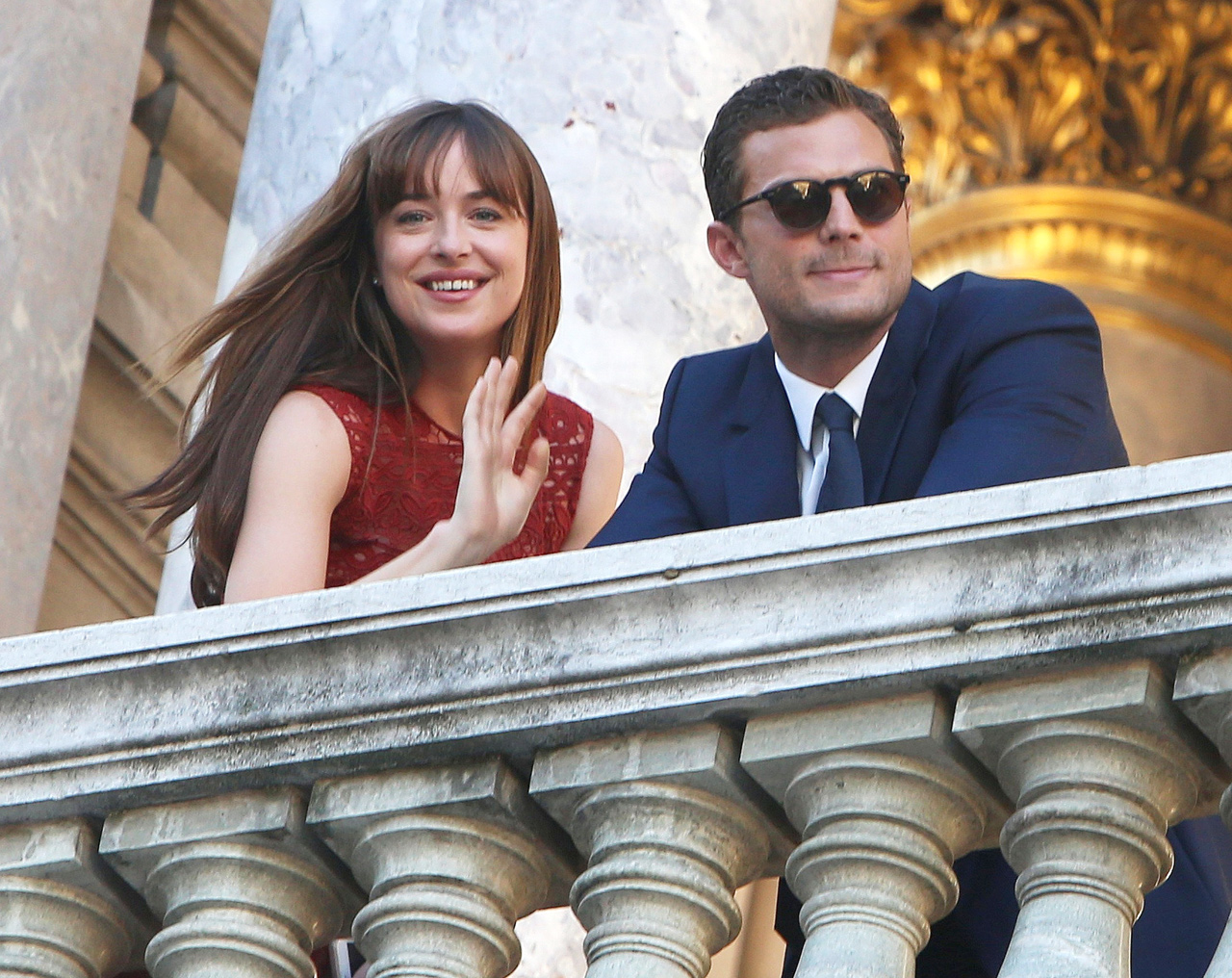 Dakota Johnson and Jamie Dornan Wave to Fans While Filming <em>Fifty Shades</em> Sequel Following Nice Attacks