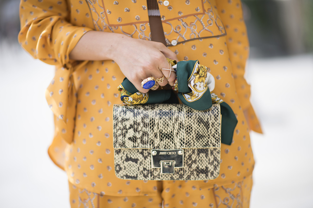 <p>With a small boxy shape, try wrapping the scarf around the top handle.</p>