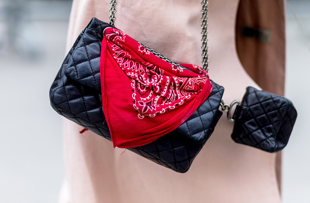 A bandana looped around the hardware of a ladylike bag gives the look rock-n-roll edge.