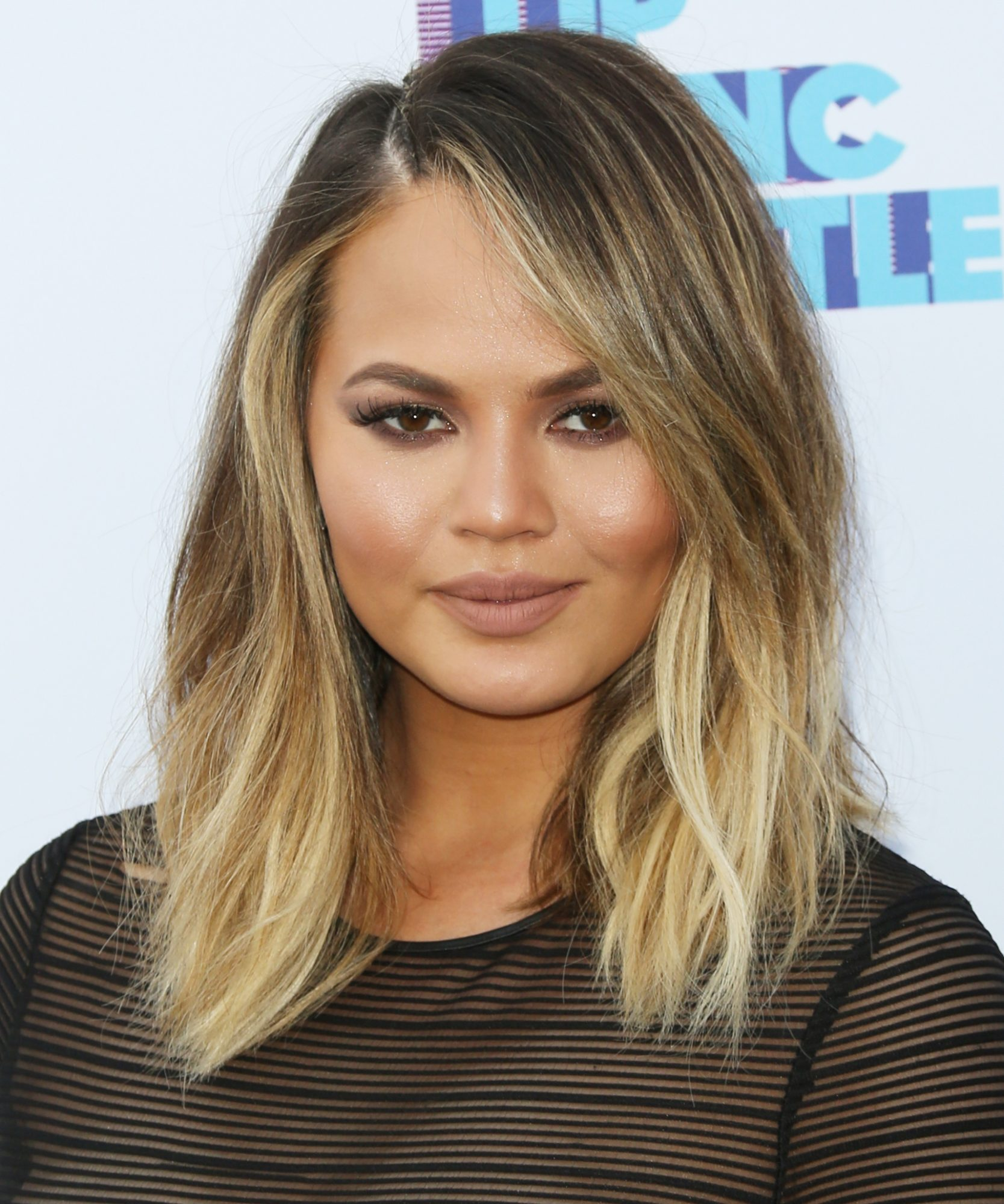 "Chrissy Teigen Hilariously Draws Attention to a Serious Style Woe: ""My Body Is Escaping My Jean Holes"""