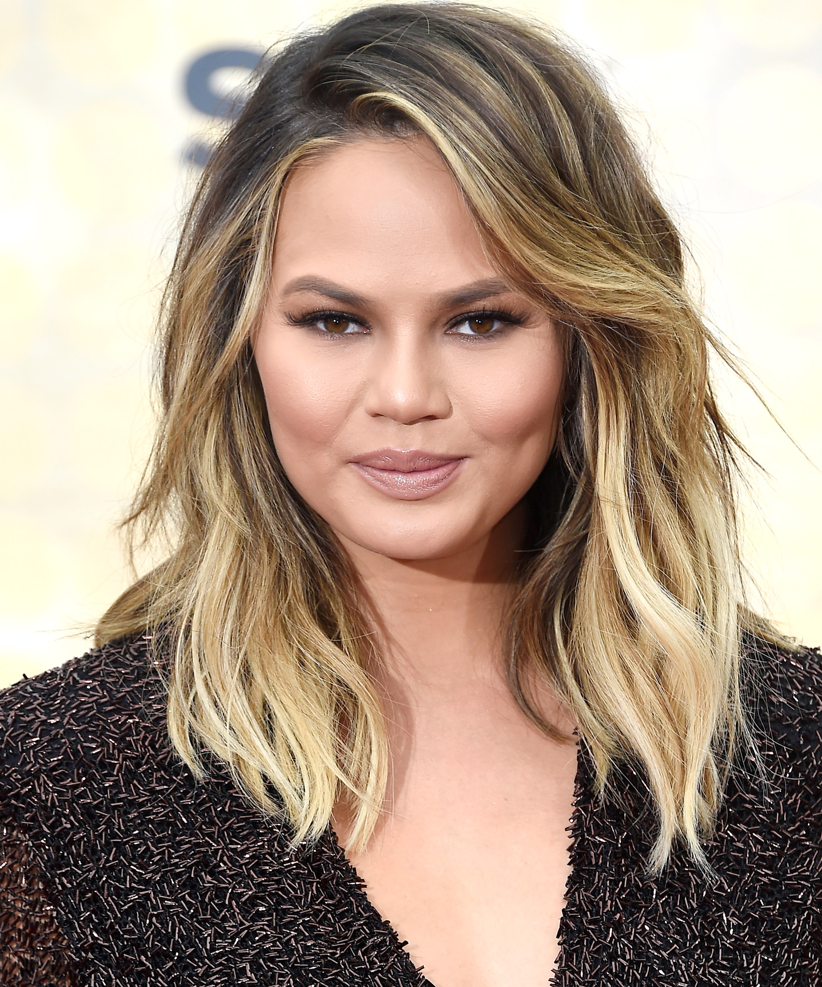 Chrissy Teigen Rocks Retro Waves and Denim Short-Shorts in L.A.