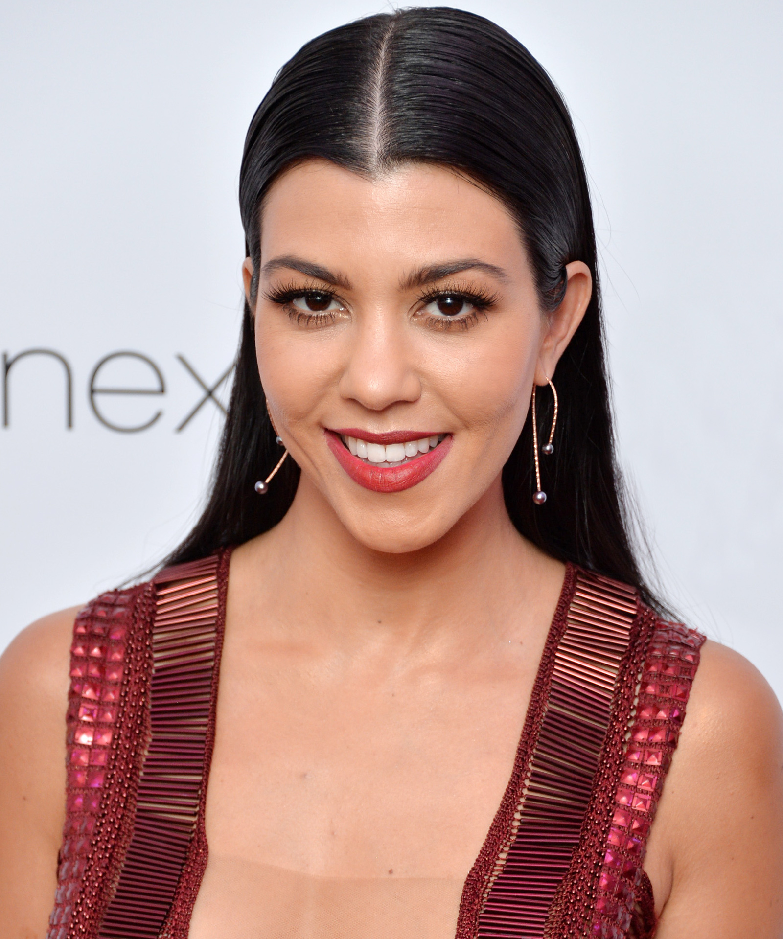 Kourtney Kardashian Is One Hot Mom in a Sheer One-Piece Swimsuit in Italy