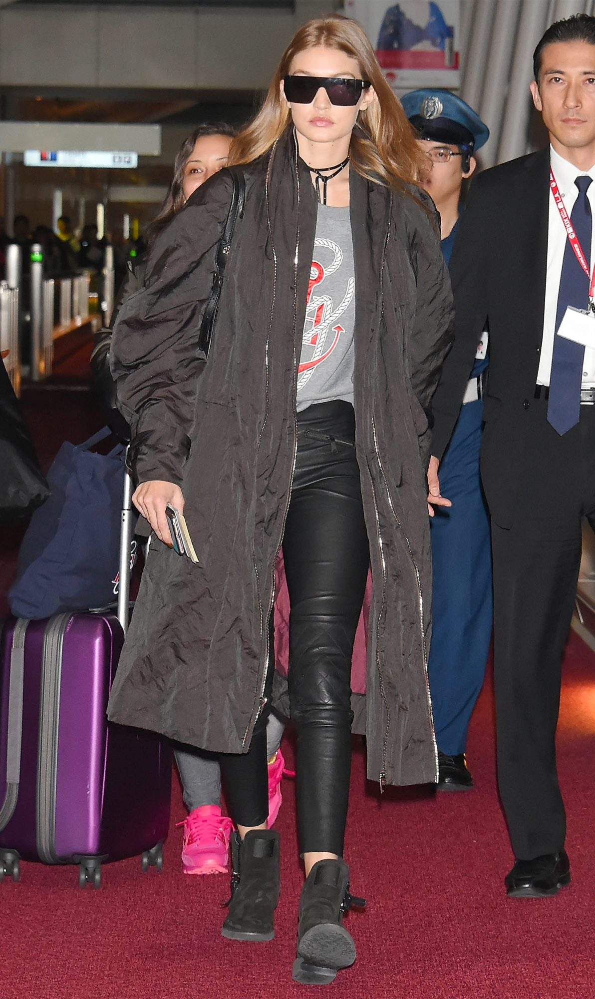 Gigi Hadid Arrives in Tokyo Wearing Edgy Leather Leggings and a Nautical Sweatshirt