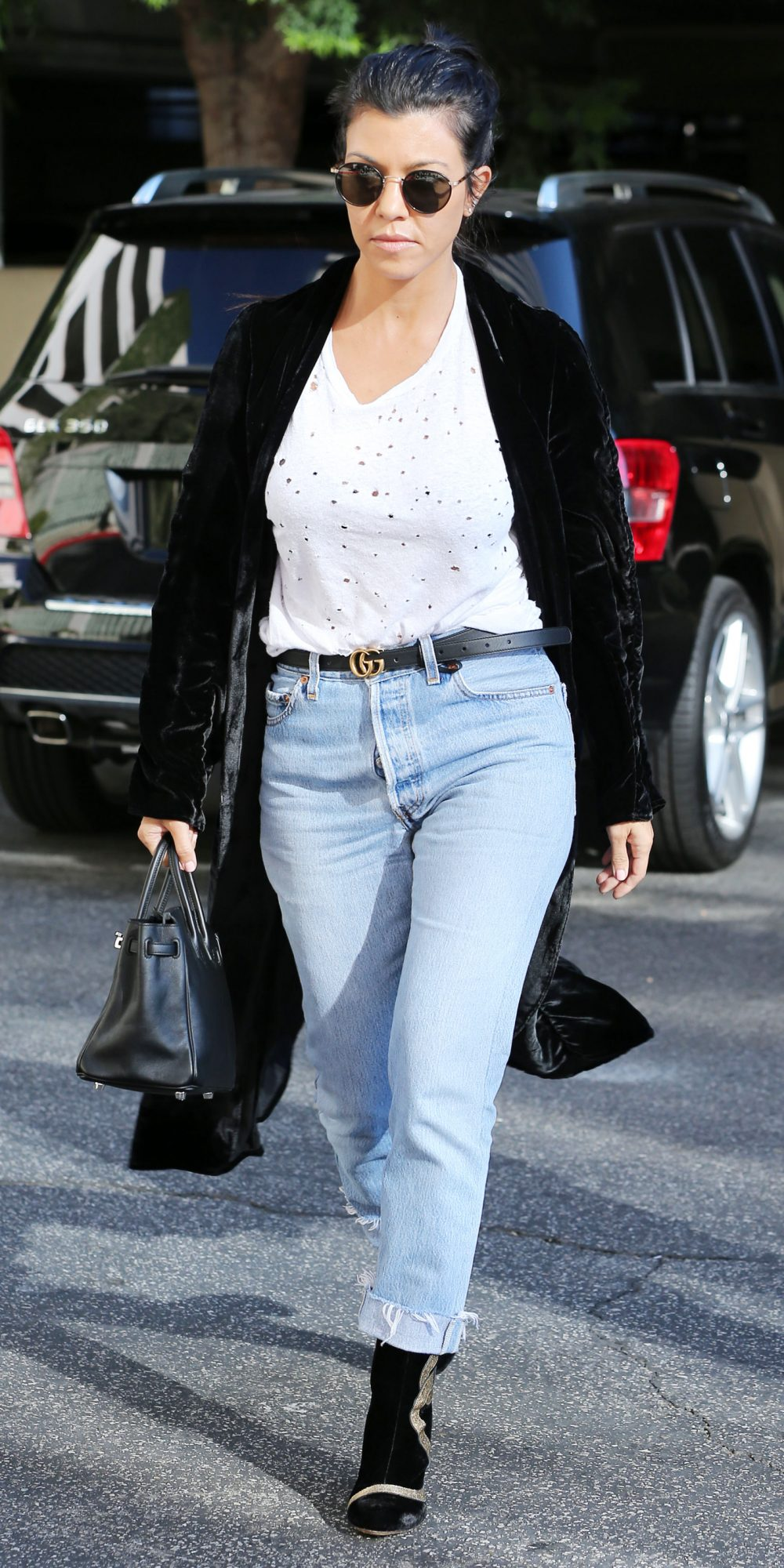 Kourtney Kardashian Elevates Casual Separates with the Addition of a Velvet Topper