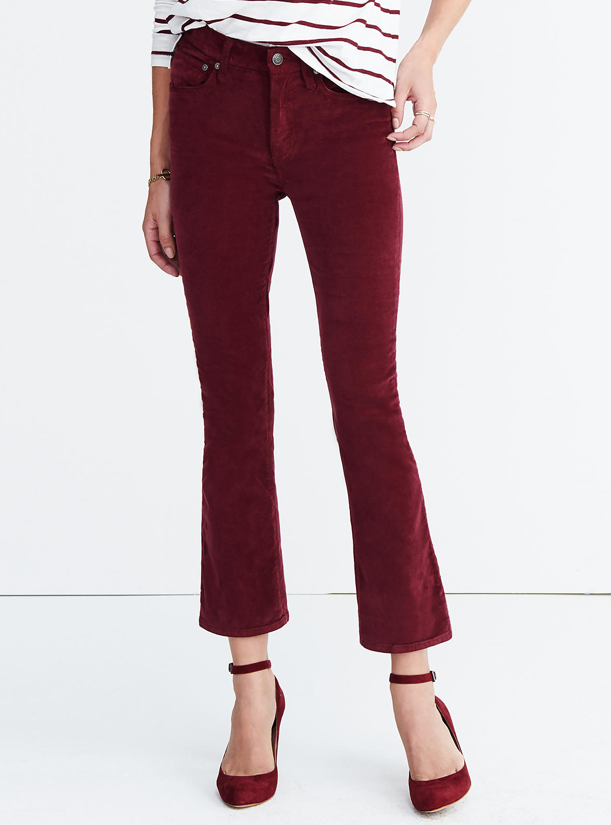 <p>Madewell red, cropped flare velvet pants</p>