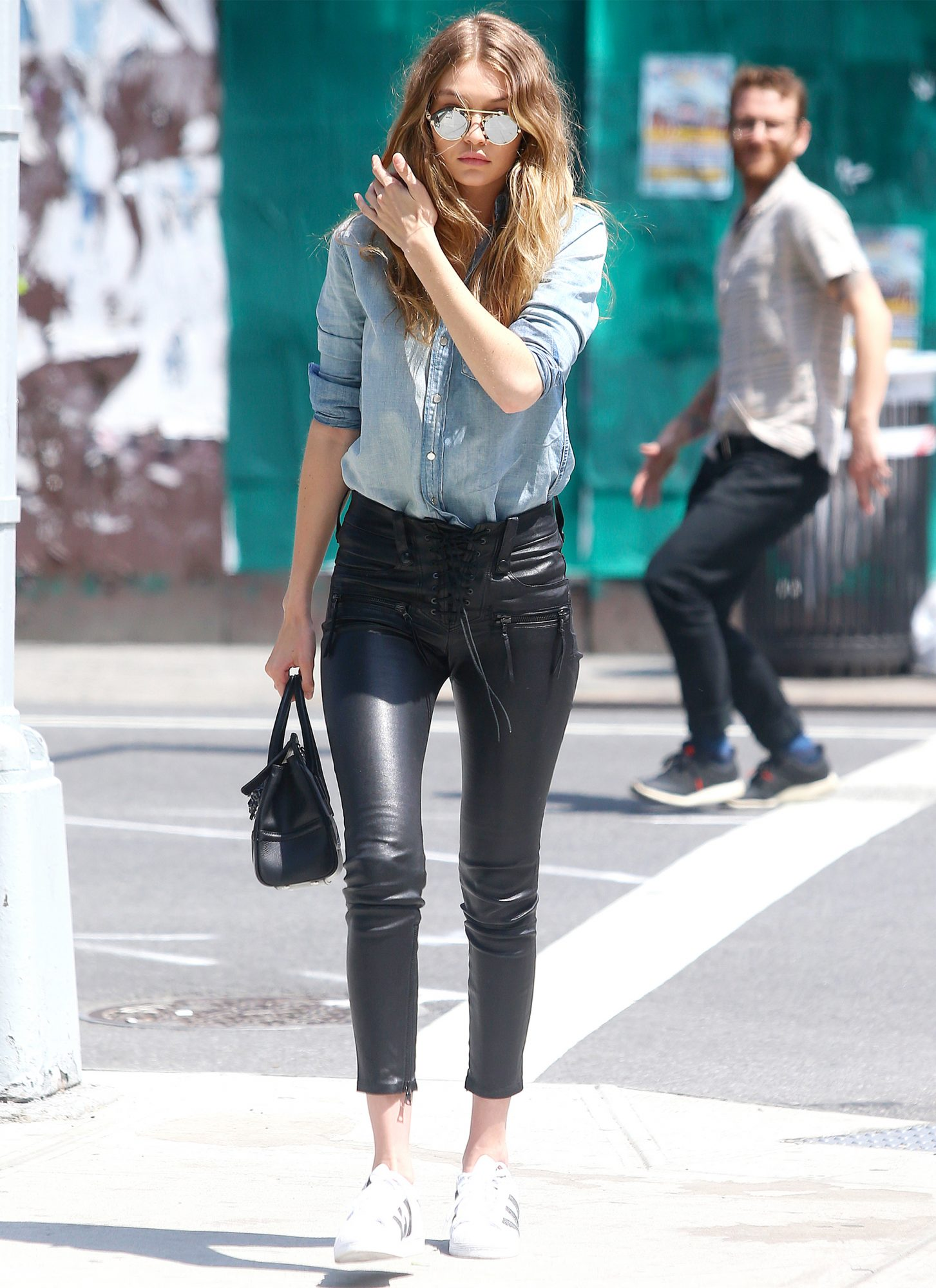 Gigi Hadid Wears Lace Up Leather Pants And Sneakers In N Y