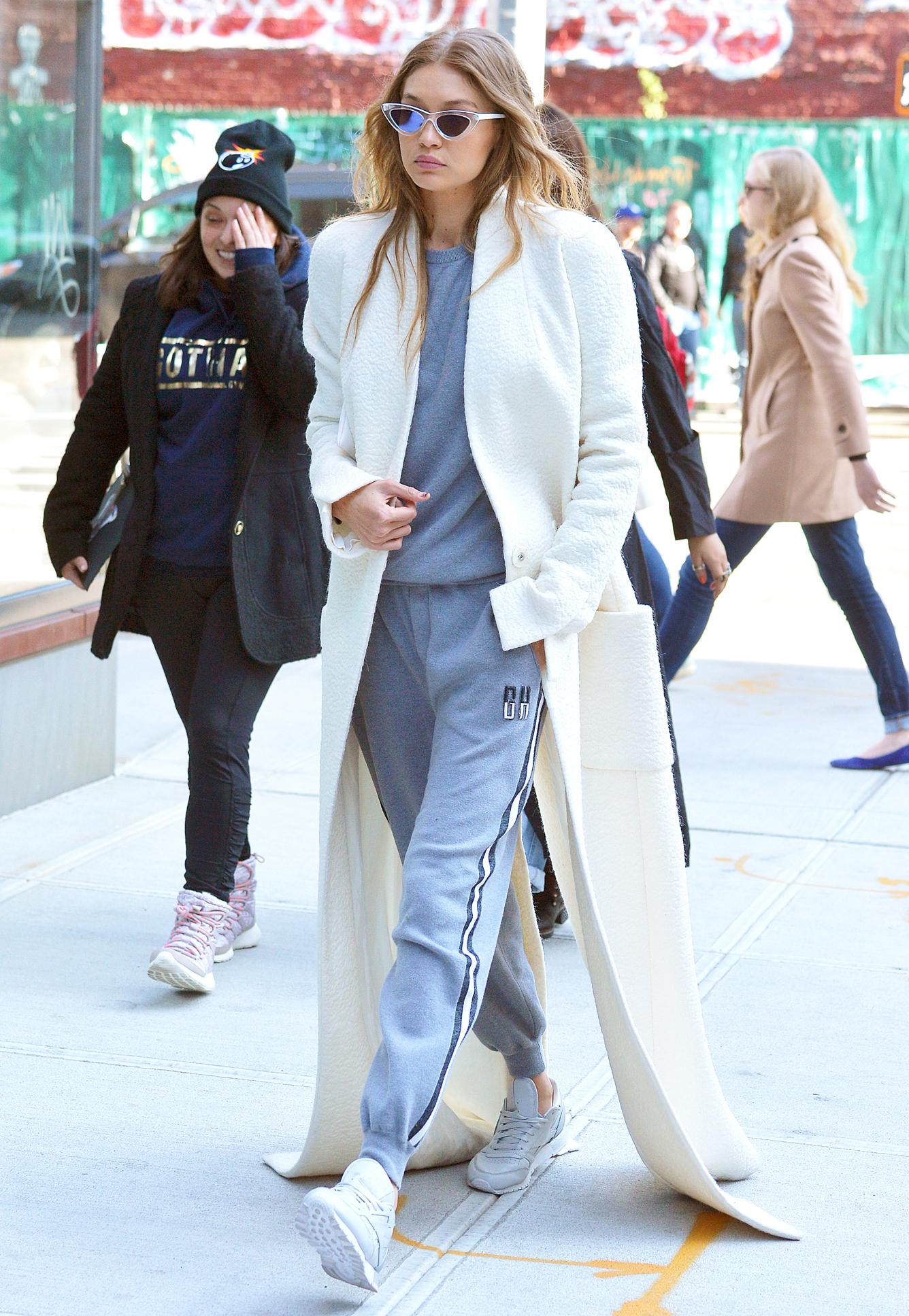 Gigi Hadid Dons a Sidewalk-Skimming White Coat in N.Y.C.
