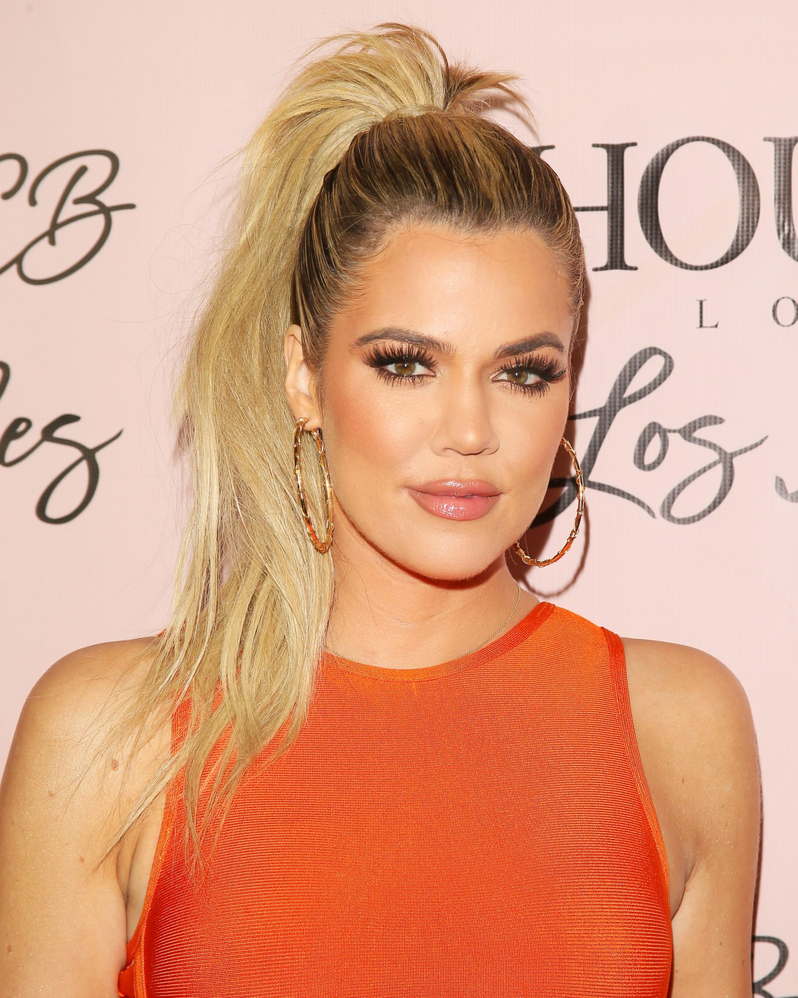 khloe new haircut khlo 233 turns heads in a curve hugging orange 1044