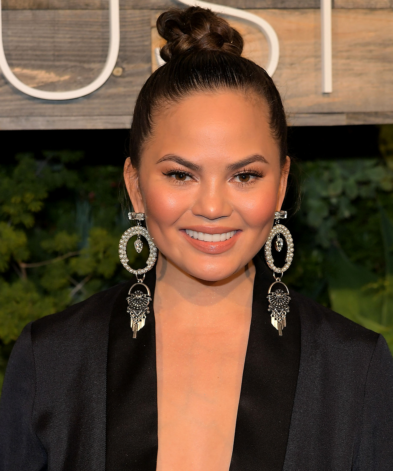 """Chrissy Teigen Describes Her Own Plastic Surgery: """"Everything About Me Is Fake Except My Cheeks"""""""