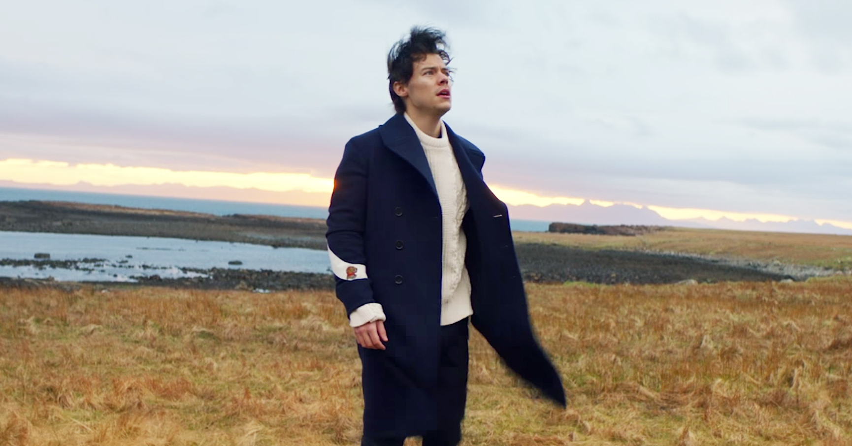 """Harry Styles Soars Through the Air in """"Sign of the Times"""" Music Video"""