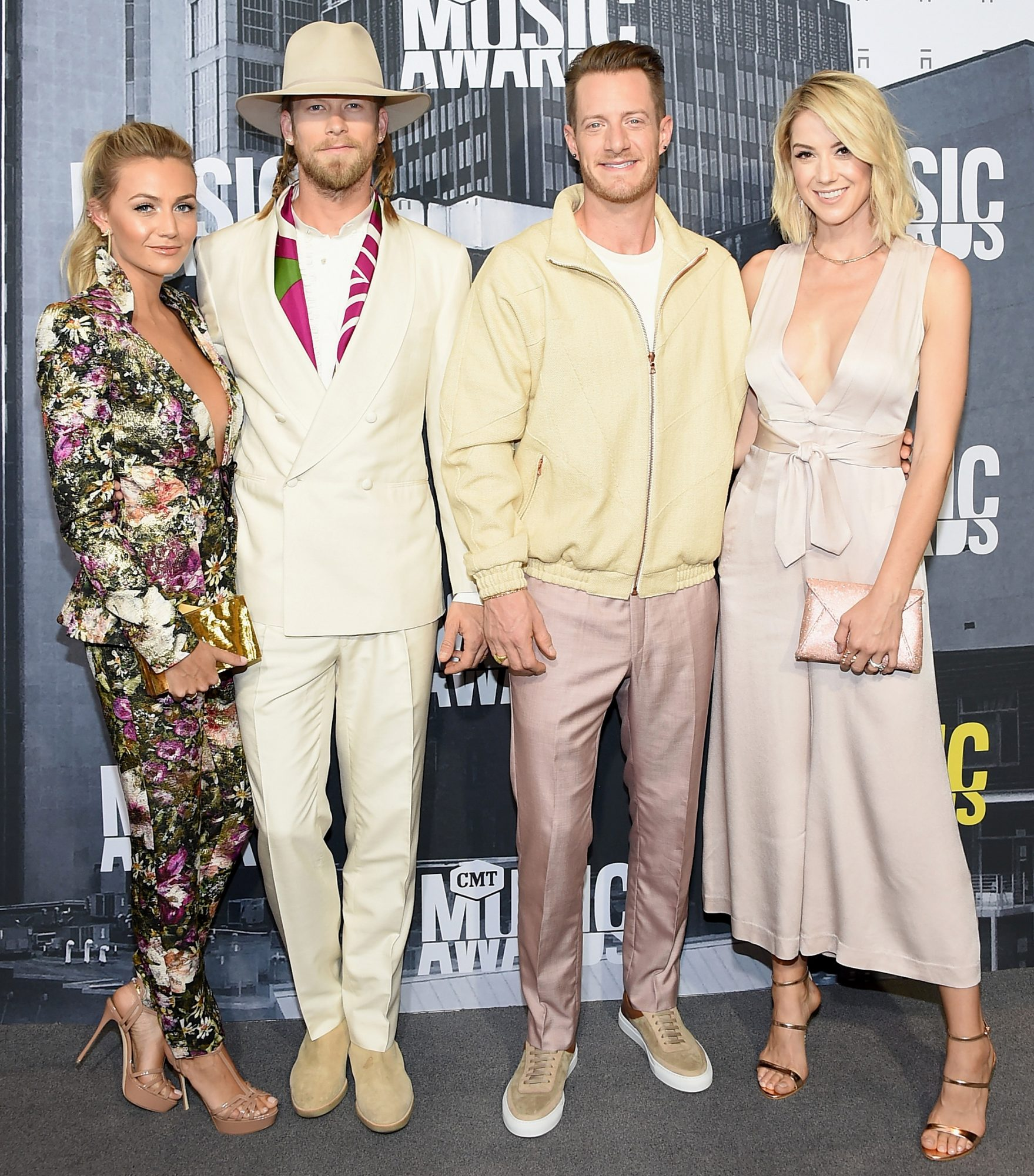 <p>Brittney Marie Cole, singers Brian Kelley and Tyler Hubbard</p>