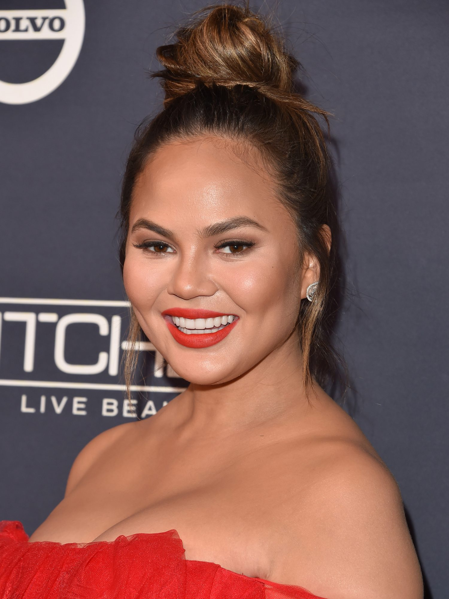 Chrissy Teigen and Her Family Pose in Matching Christmas Pajamas in January