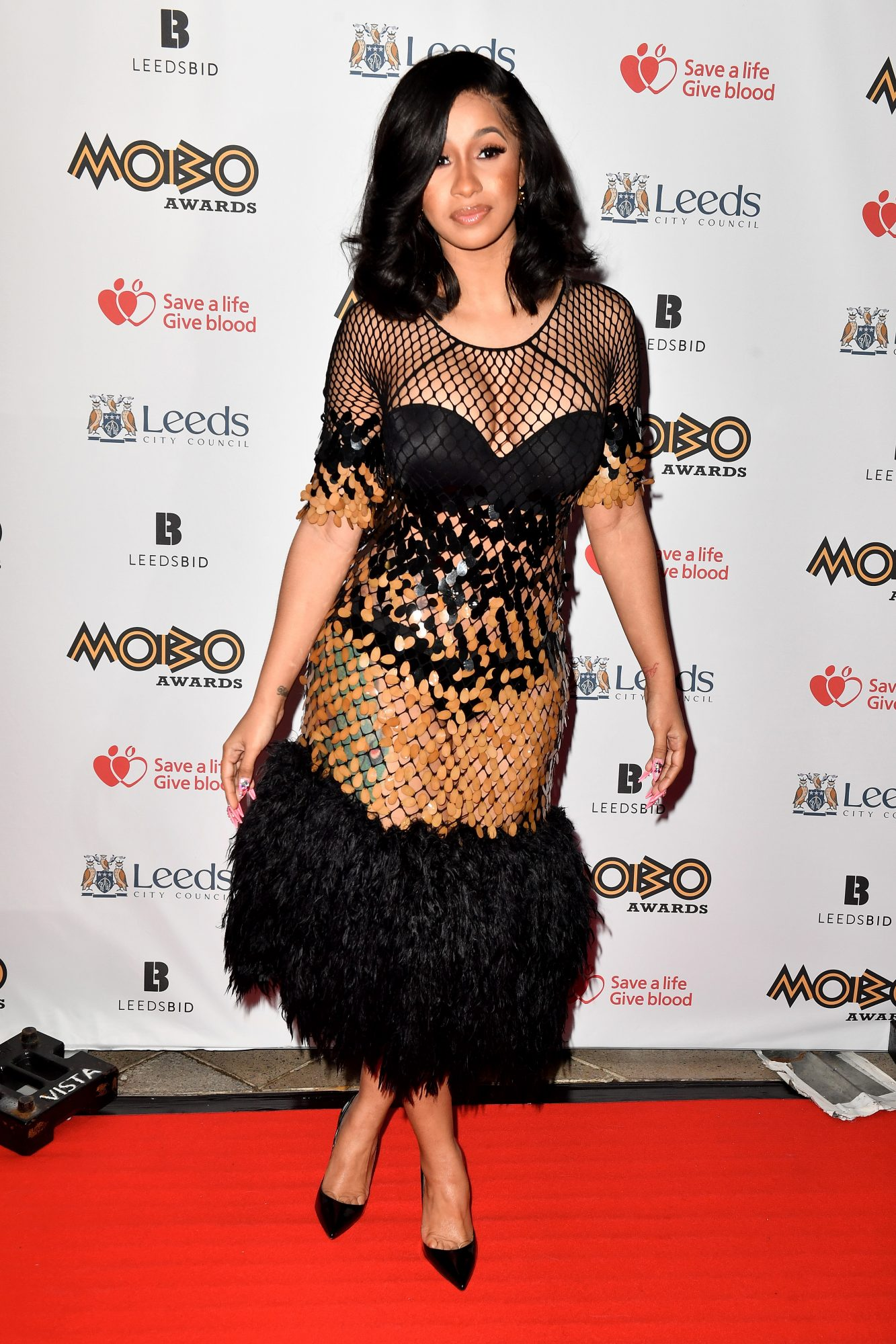<p>Feathers, sequins, and a little mesh on top</p>