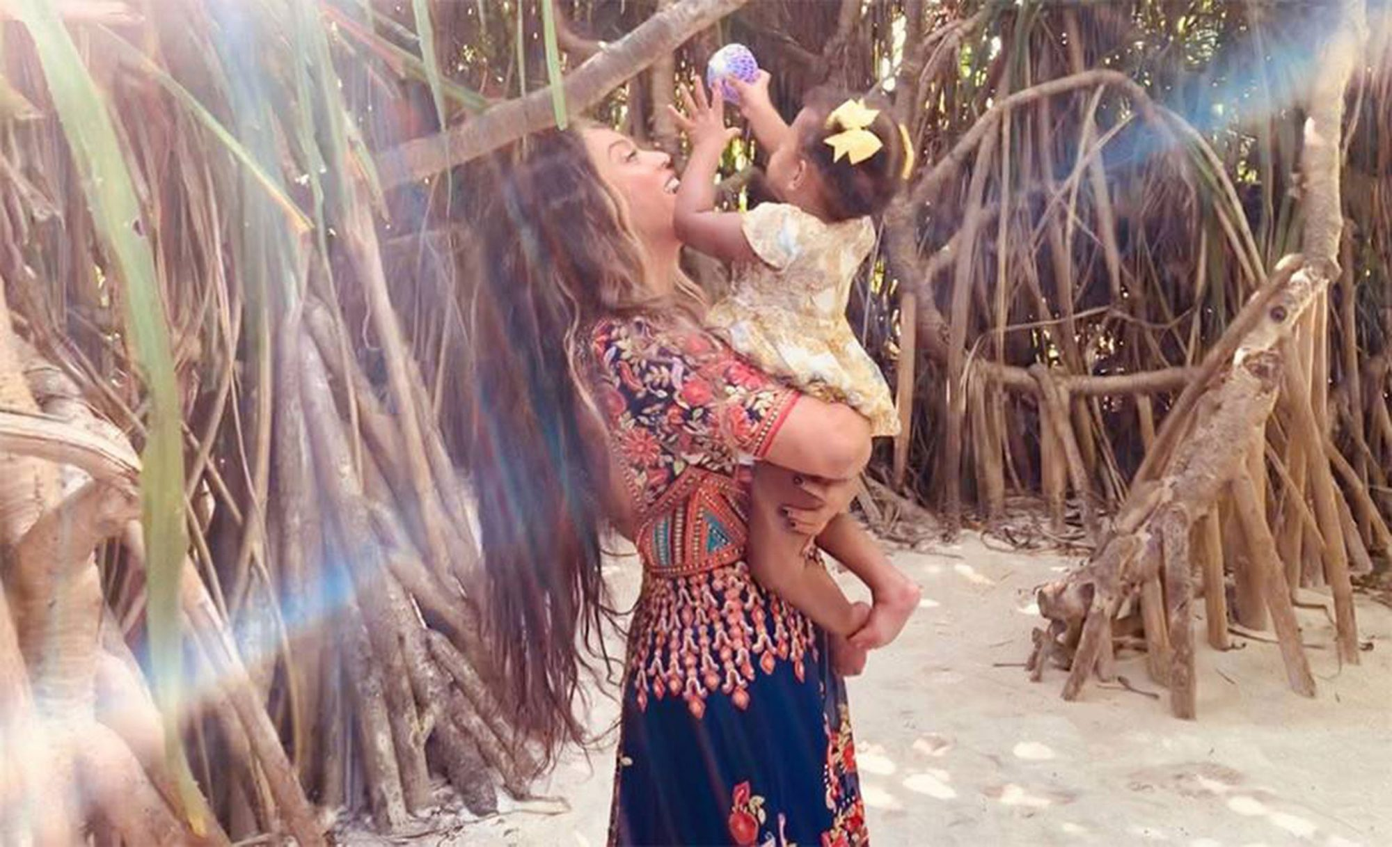 Beyoncé Pulls a Santa Claus, Releases Rare Photos of Twins Rumi and Sir