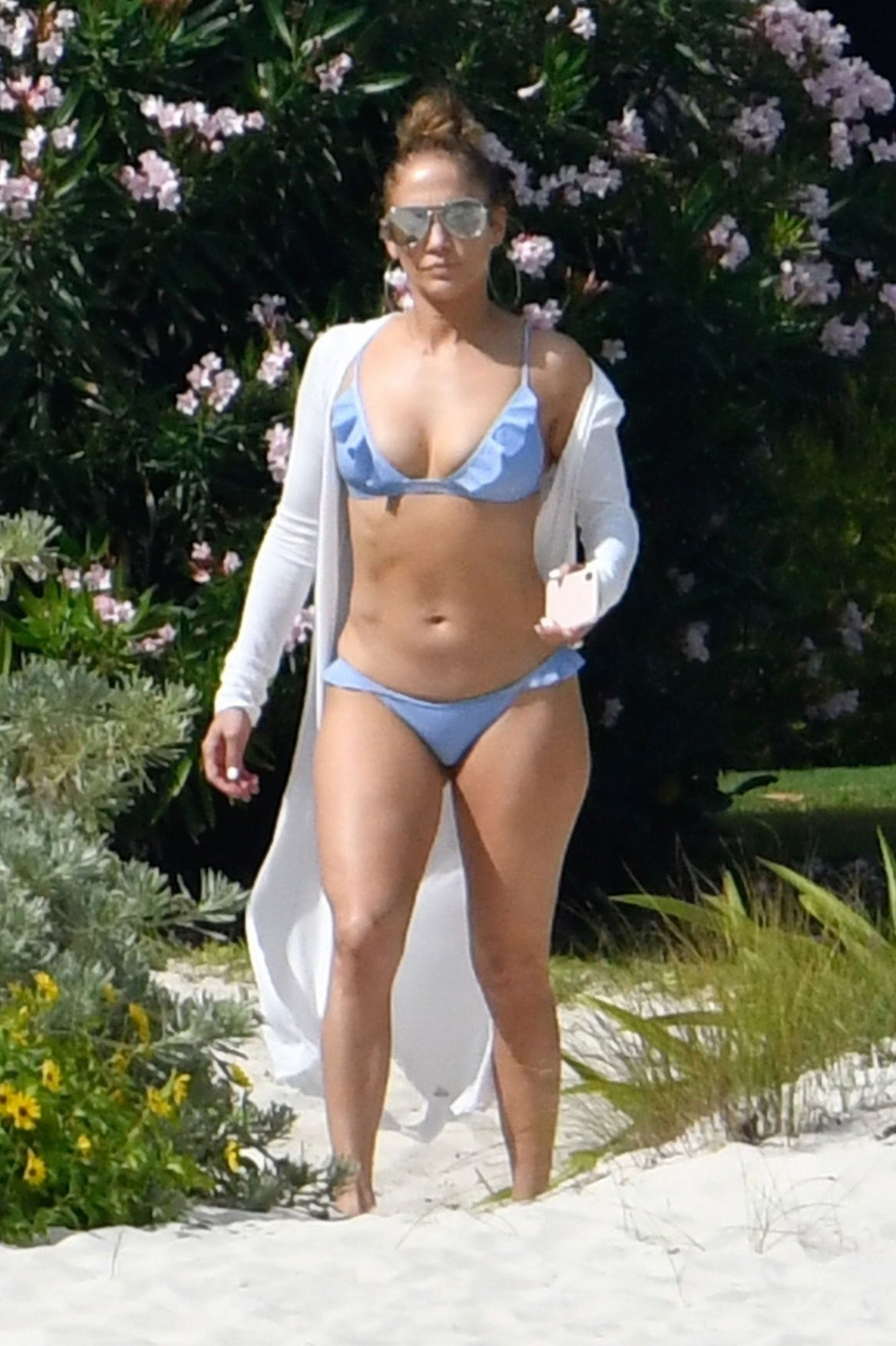 dd9783daff5f The Trendy Swimsuit Jennifer Lopez Wore Twice on Her Engagement Trip ...