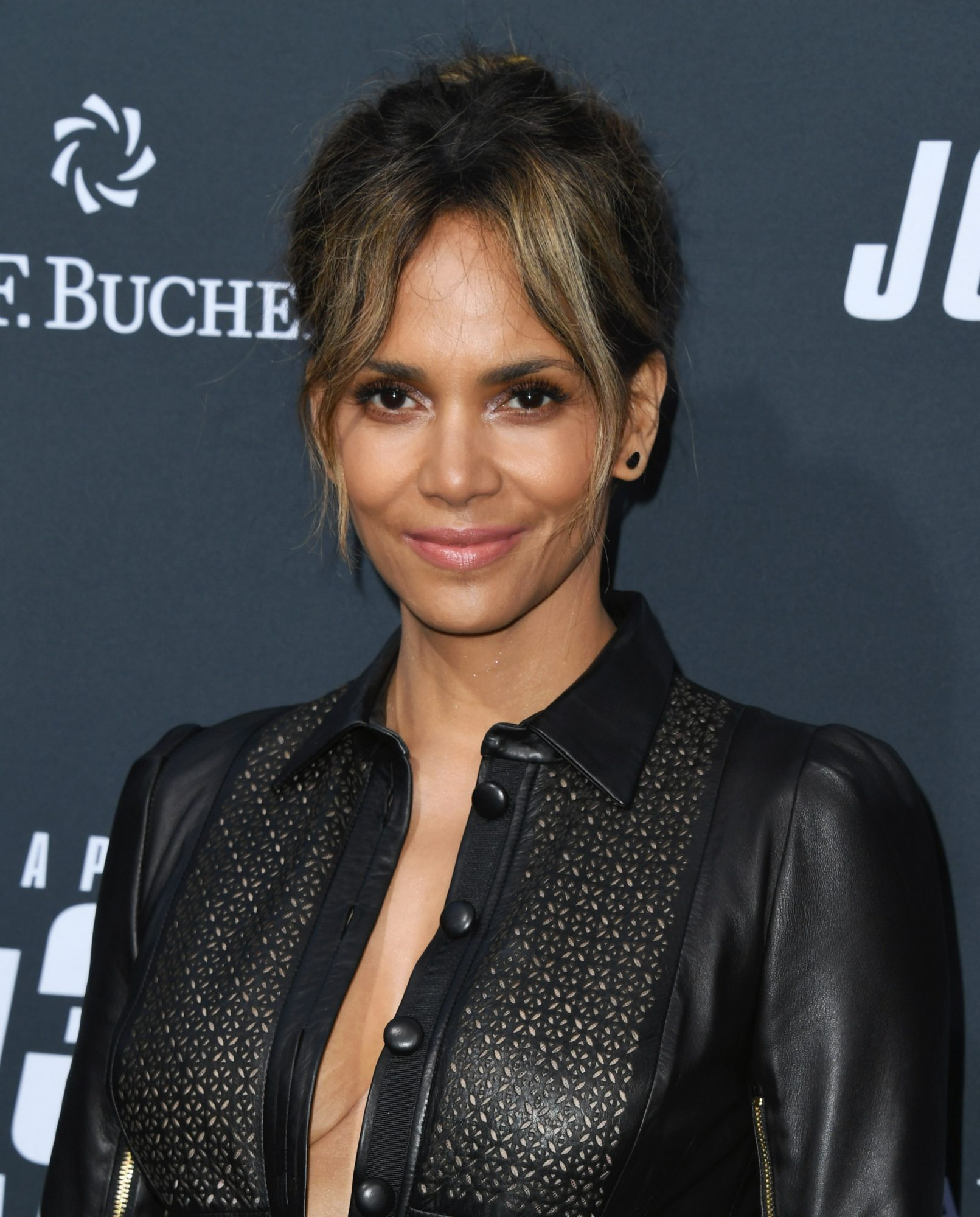Halle Berry Made a <em>Catwoman</em> Callback in a Sheer Leather Romper