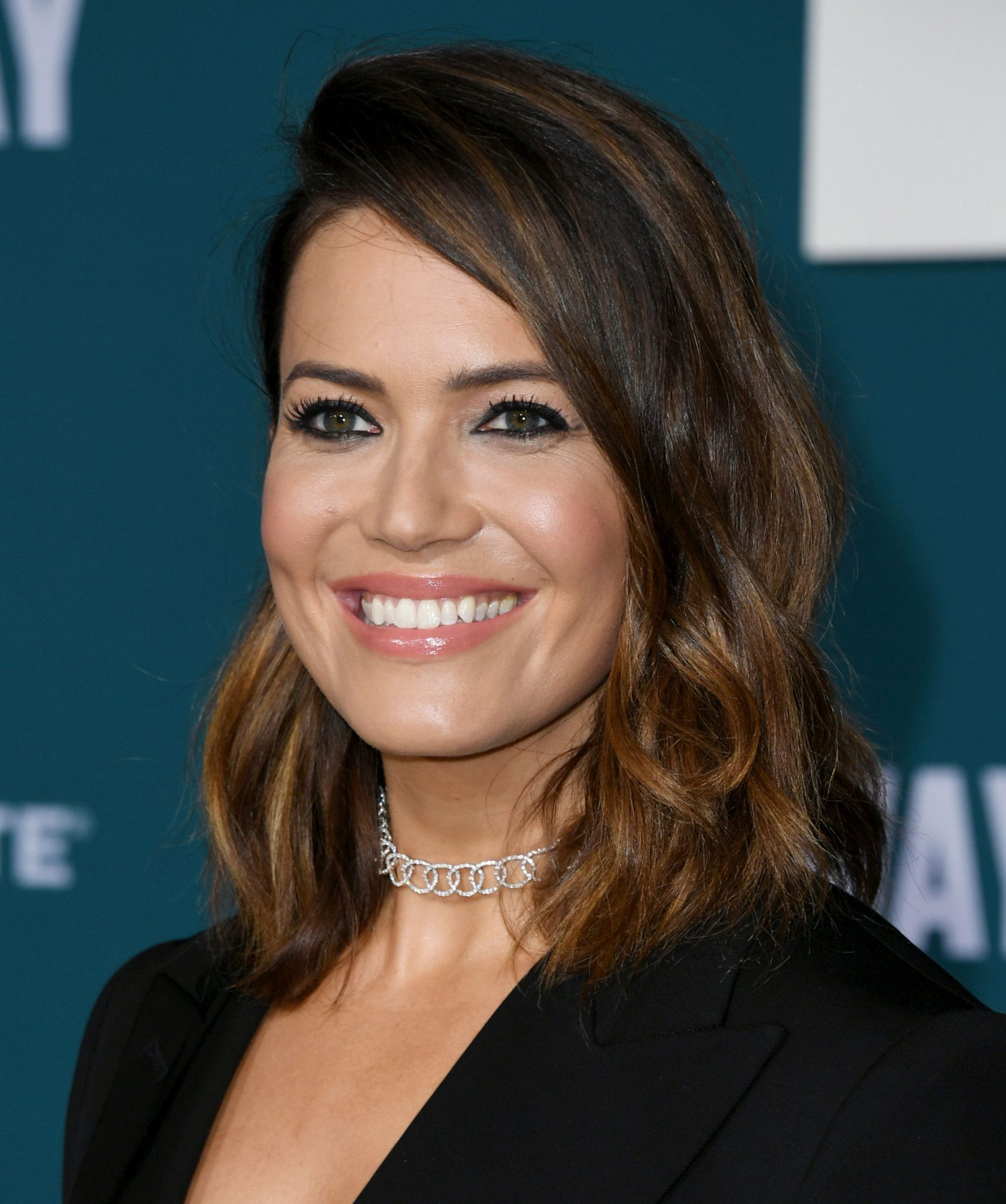 This $7 Product Is How Mandy Moore Keeps Her Brown Hair from Getting Brassy