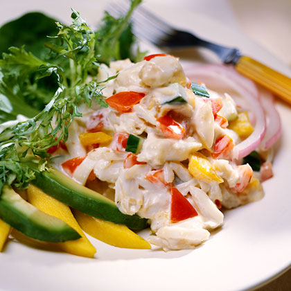 Caribbean Crabmeat Salad With Creamy Gingered Dressing RecipeNothing brings the flavor of the Caribbean to the table like the taste of fresh seafood. Mix crabmeat with diced tomatoes and cucumbers, then toss with a gingered Dijon dressing and serve with sliced fruits and veggies. Try this in place of your usual chicken or tuna salad.