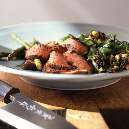 Asian Flank Steak with Asparagus and Wild-Rice Pilaf RecipeFlank steak and asparagus grill side-by-side, generating amazing flavor and texture. Serve with wild rice pilaf to complete the meal.